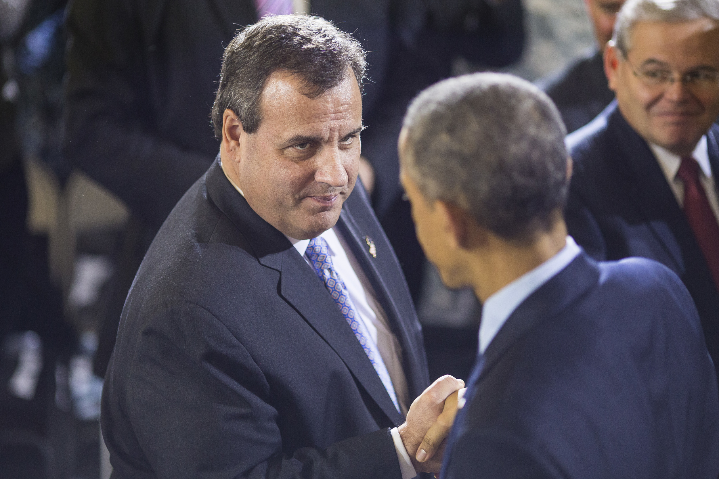 New Jersey Gov. Chris Christie shakes hands with President Obama after he delivered remarks expressing his gratitude for the service and sacrifice of troops and their families at Joint Base McGuire-Dix-Lakehurst in Joint Base McGuire-Dix-Lakehurst, NJ on Monday December 15, 2014.