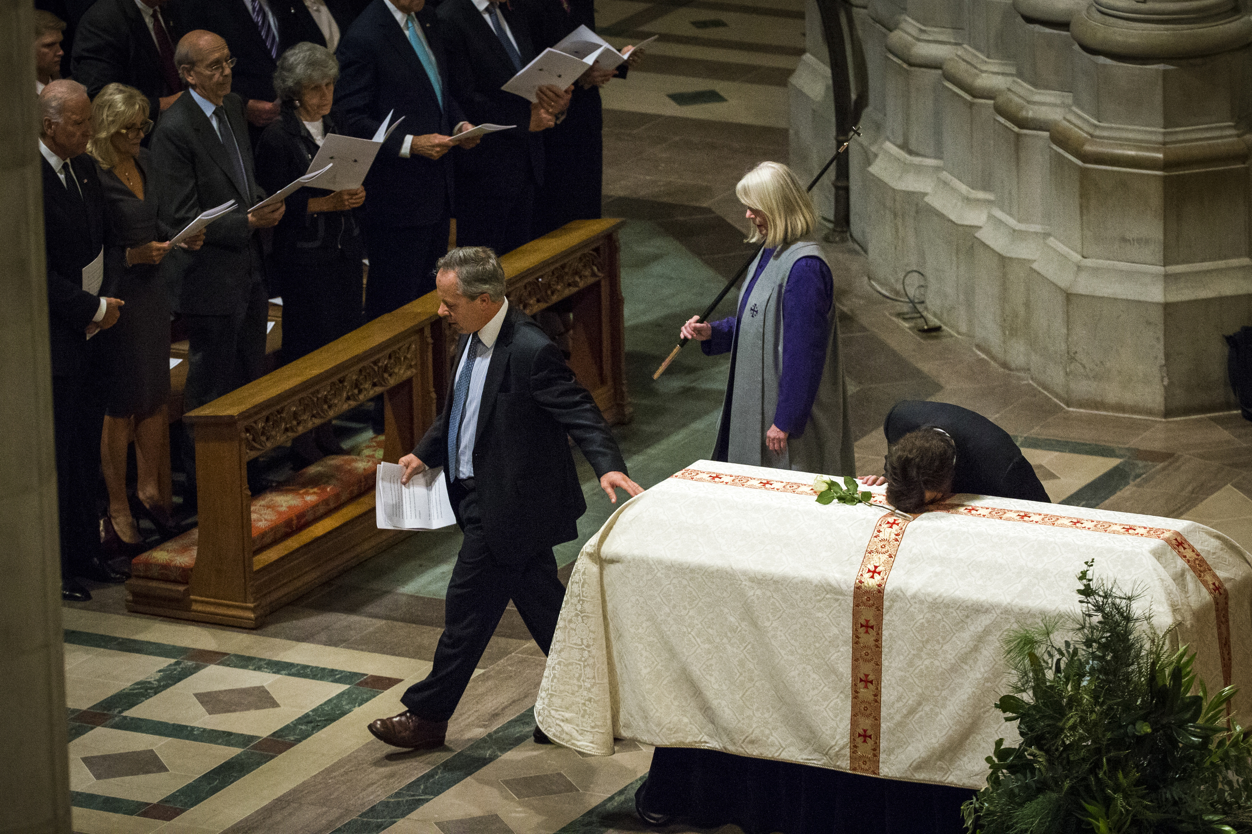 Quinn Bradlee, a son of former Washington Post executive editor Benjamin C. Bradlee, rests his head on his fathers casket after he spoke at his father's funeral at the Washington National Cathedral in Washington, DC on Wednesday October 29, 2014.