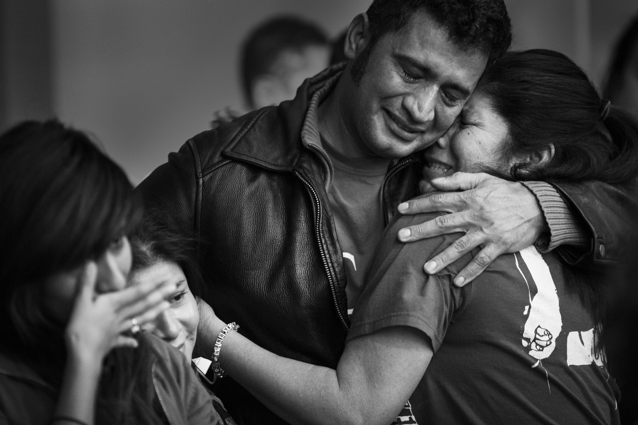 Oscar Alfaro hugs his aunt, Carmen Paz, who is like a mother, during a party to watch President Obama describe the outlines of his plans for temporary amnesty at Casa de Maryland in Hyattsville, MD on Thursday November 20, 2014.