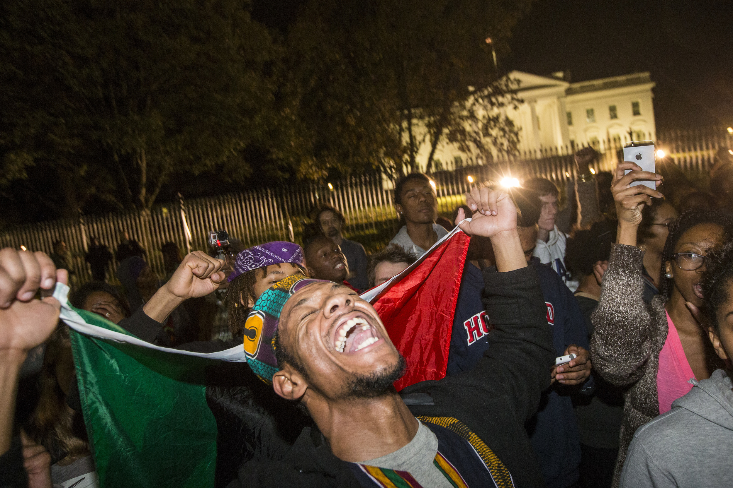 Jason Davis, 20, from Howard University shouts as protestors shout and chant in front of the White House after a grand jury in Ferguson chose not to indict Darren Wilson from Ferguson in Washington, DC on Monday November 24, 2014.