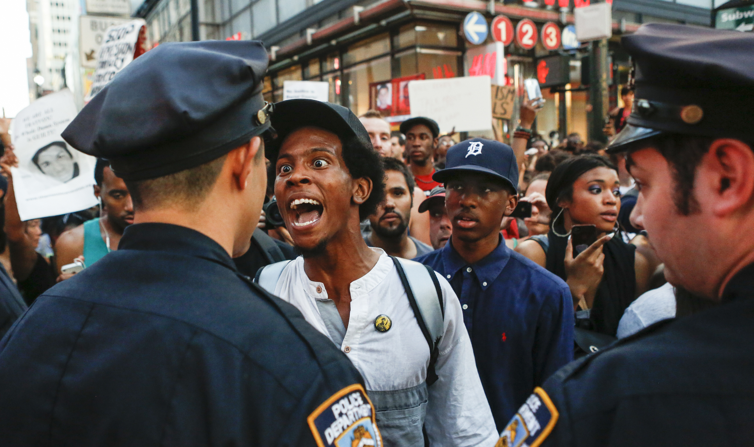 A day after George Zimmerman was acquitted of all charges in the shooting death of Trayvon Martin, a man argues with New York City police officers at West 34th Street on July 14, 2013. He and thousands of other protesters who questioned the verdict of the trial blocked traffic as they made their way from Union Square to Times Square.