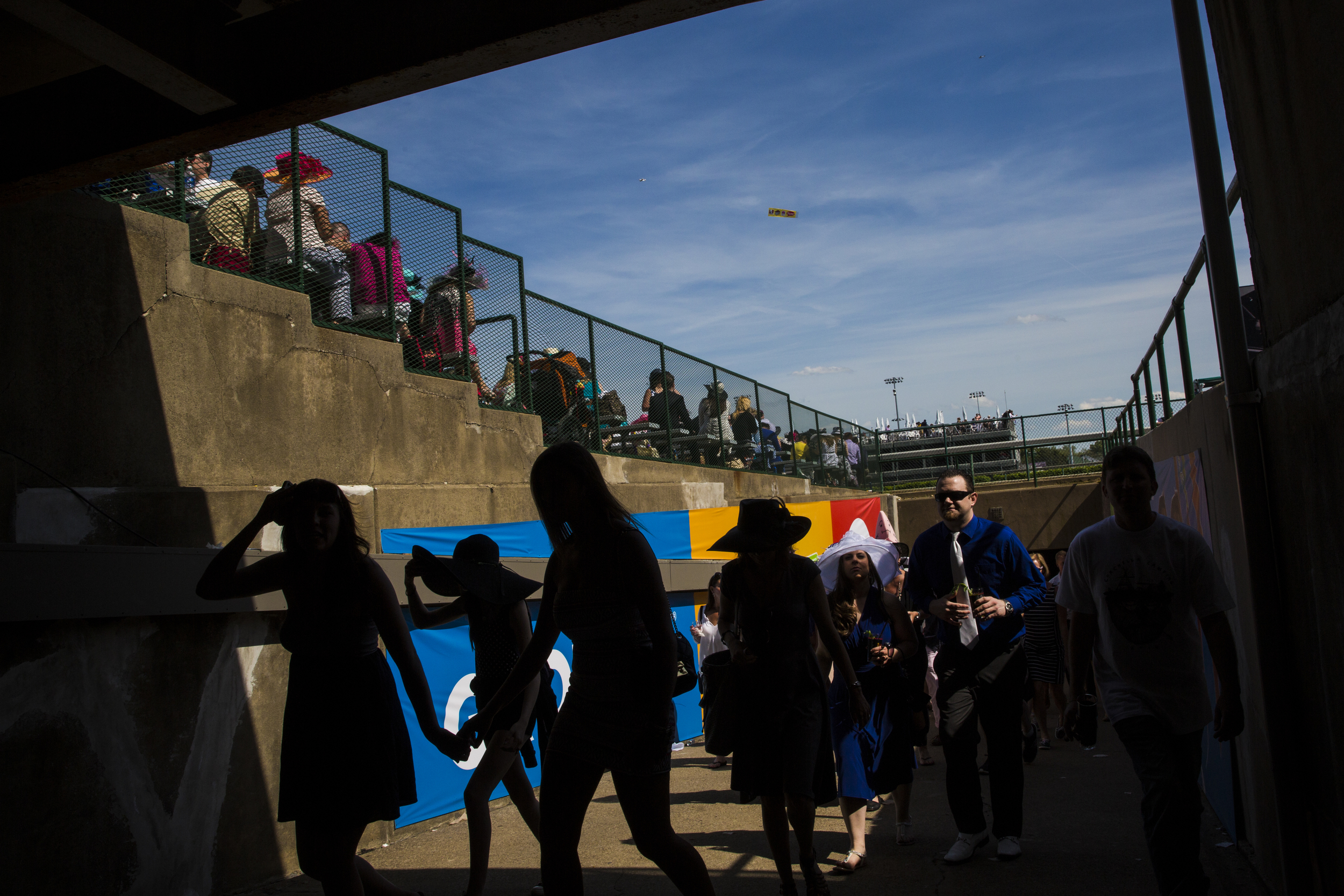 Patrons walk trough a tunnel from the infield to the grandstands on the day of the 140th Kentucky Derby at Churchill Downs in Louisville, Ky. on Saturday May 03, 2014.