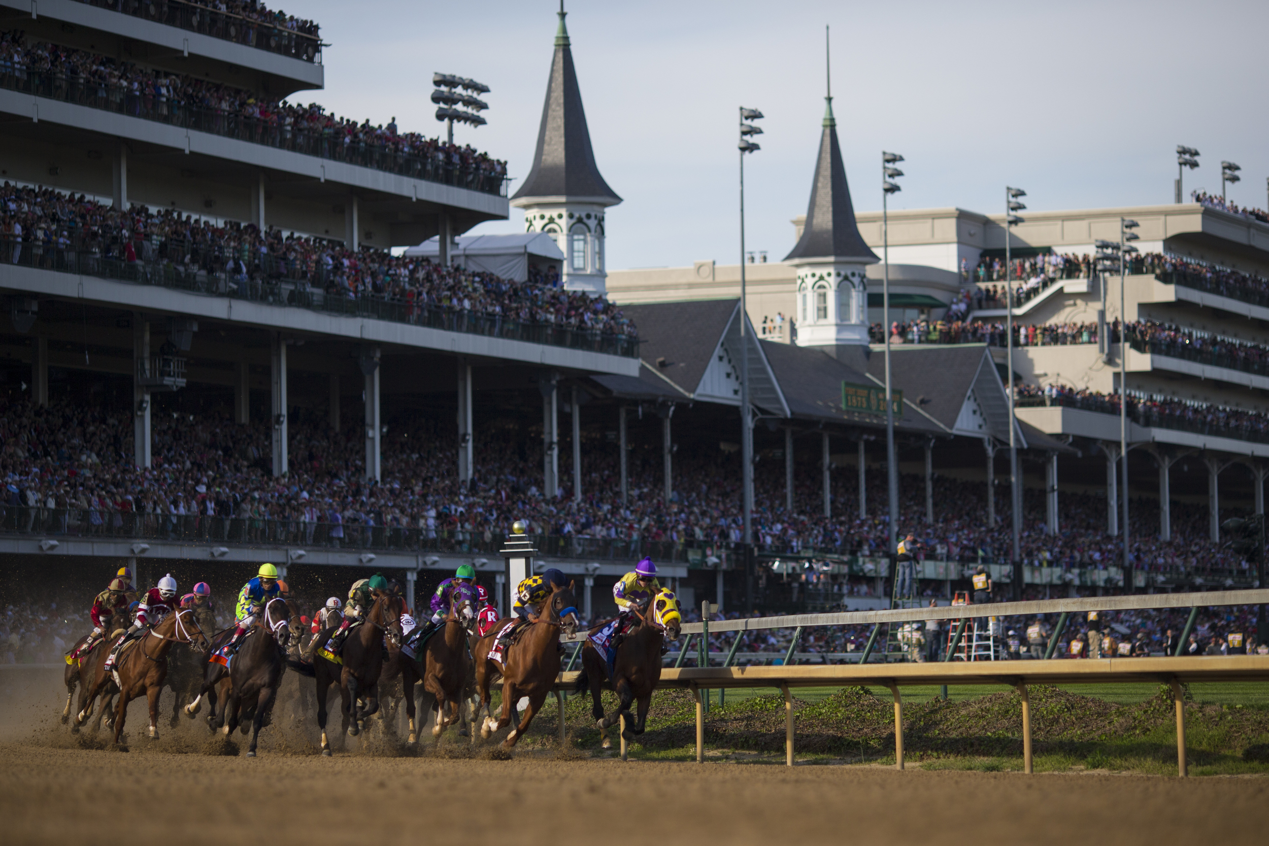 Horses round the first corner as California Chrome wins during the 140th Kentucky Derby at Churchill Downs in Louisville, Ky. on Saturday May 03, 2014.