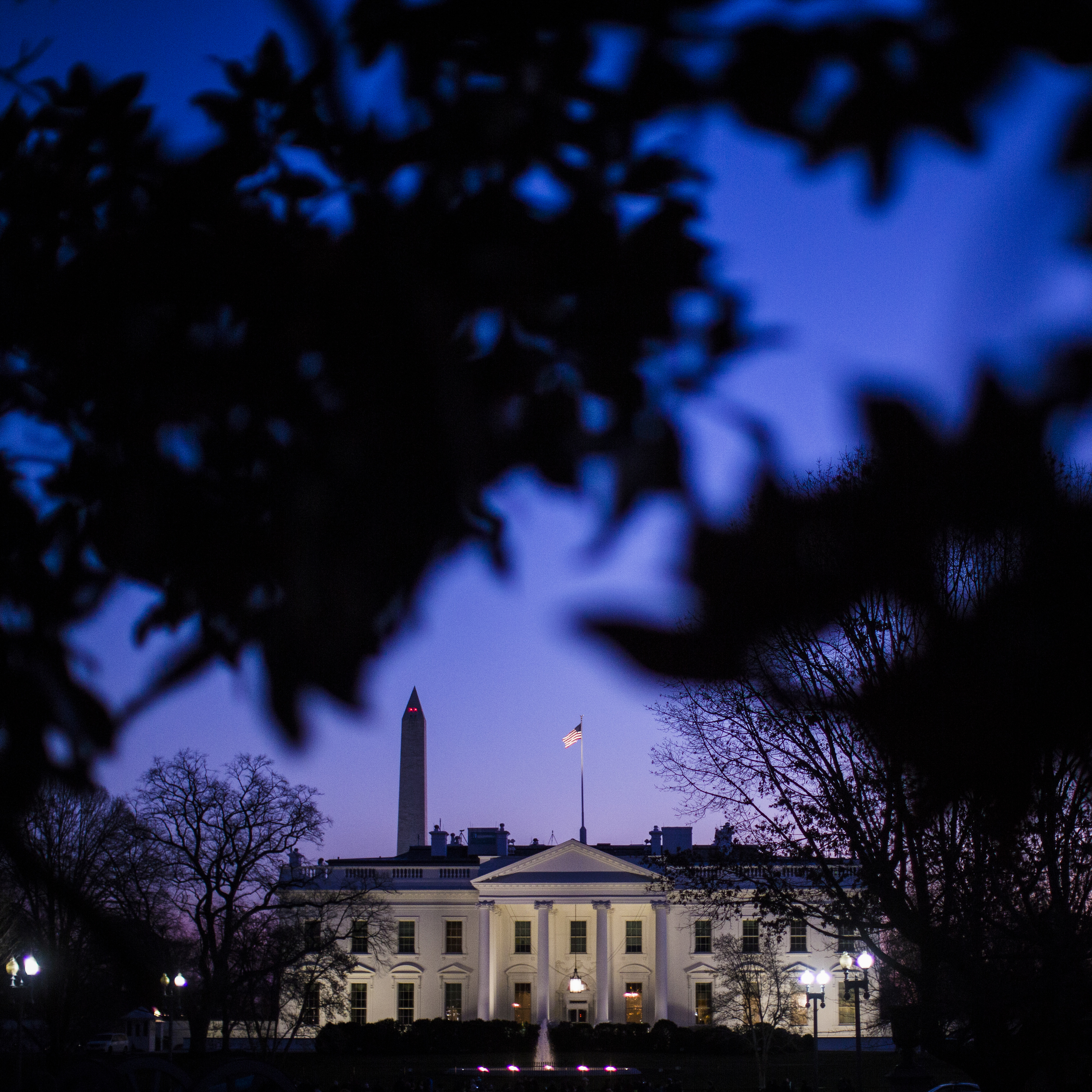 The White House is seen at sunset while President Barack Obama and his family are in Hawaii for their annual Christmas vacation trip in Washington, DC on Tuesday December 30, 2014.