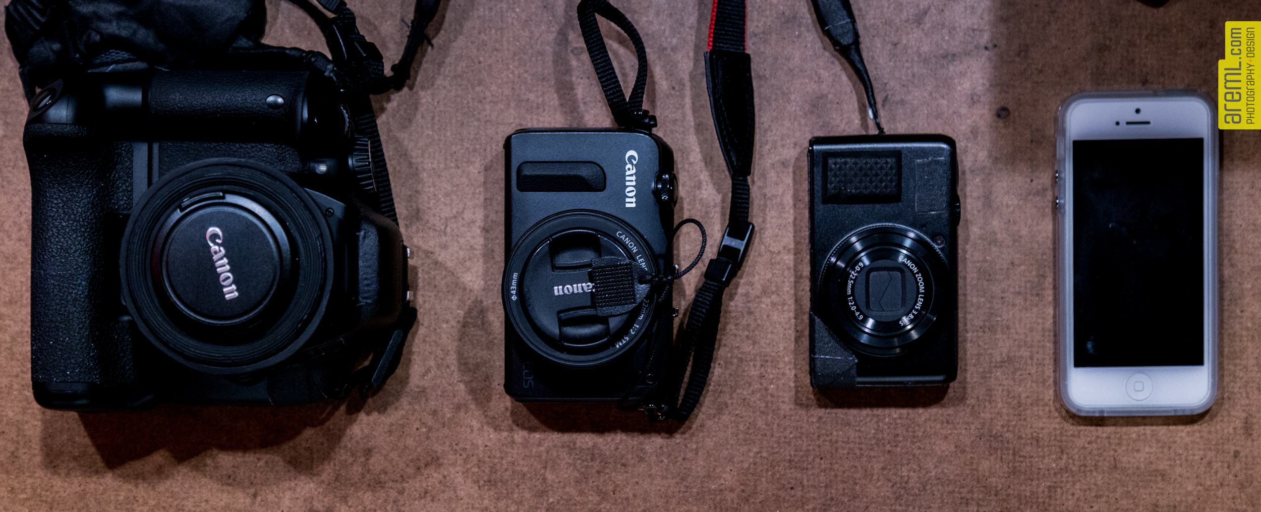 Starting on the left: Canon EOS T2i with 40mm pancake, EOS M w 22mm, Canon Powershot s90 and my iPhone 5.