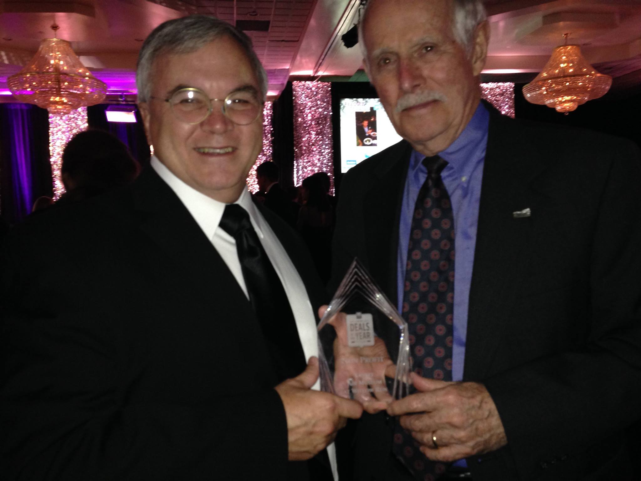 """Dennis Norton and Ray Hunter accept the MLive Media Group's """"Deals of the Year"""" Award (Nonprofit Category) on behalf of the Yankee Air Museum."""