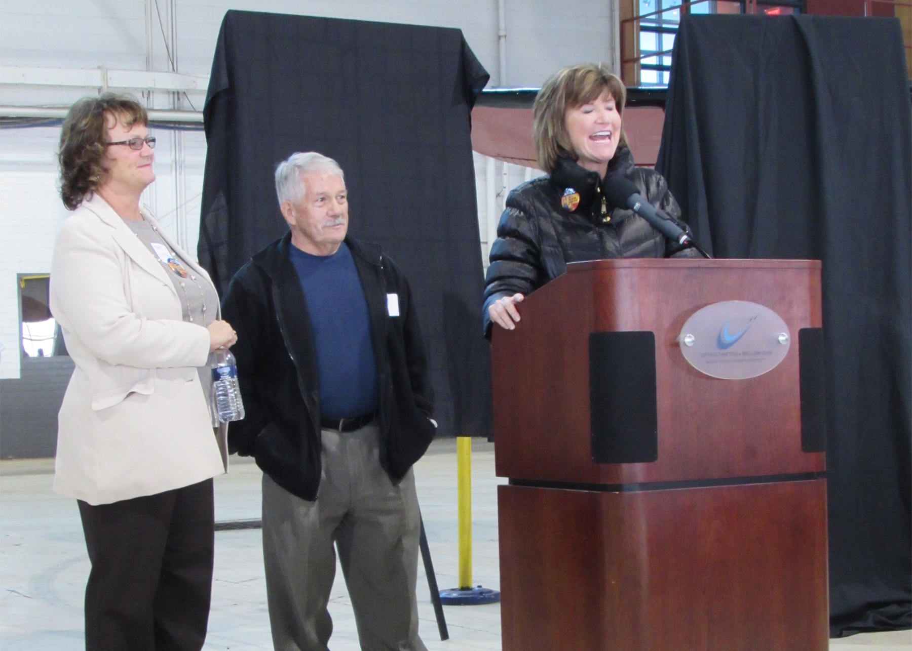 Ypsilanti Township SUpervisor Brenda Stumbo speaks at the October 30, 2014 event at which Yankee Air Museum announced its official purchase of a portion of the historic Willow Run Bomber Plant.
