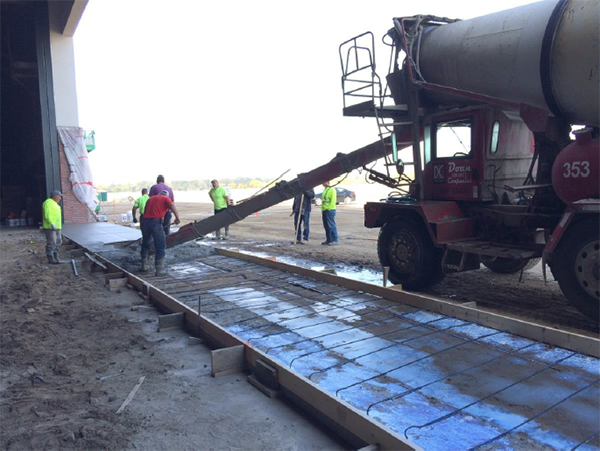 Pouring concrete for the new hangar door on the north side of the building.