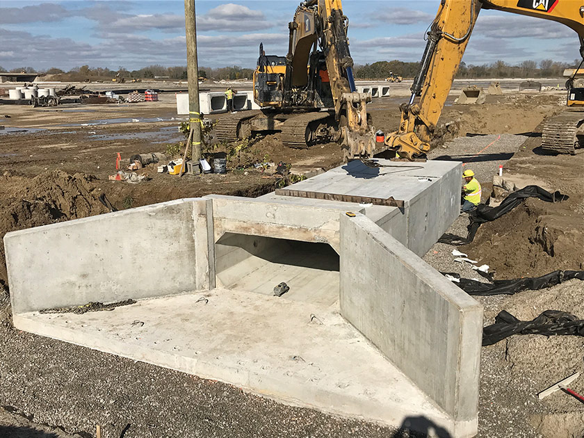 Installation of a portion of the box culvert system to drain the parking areas