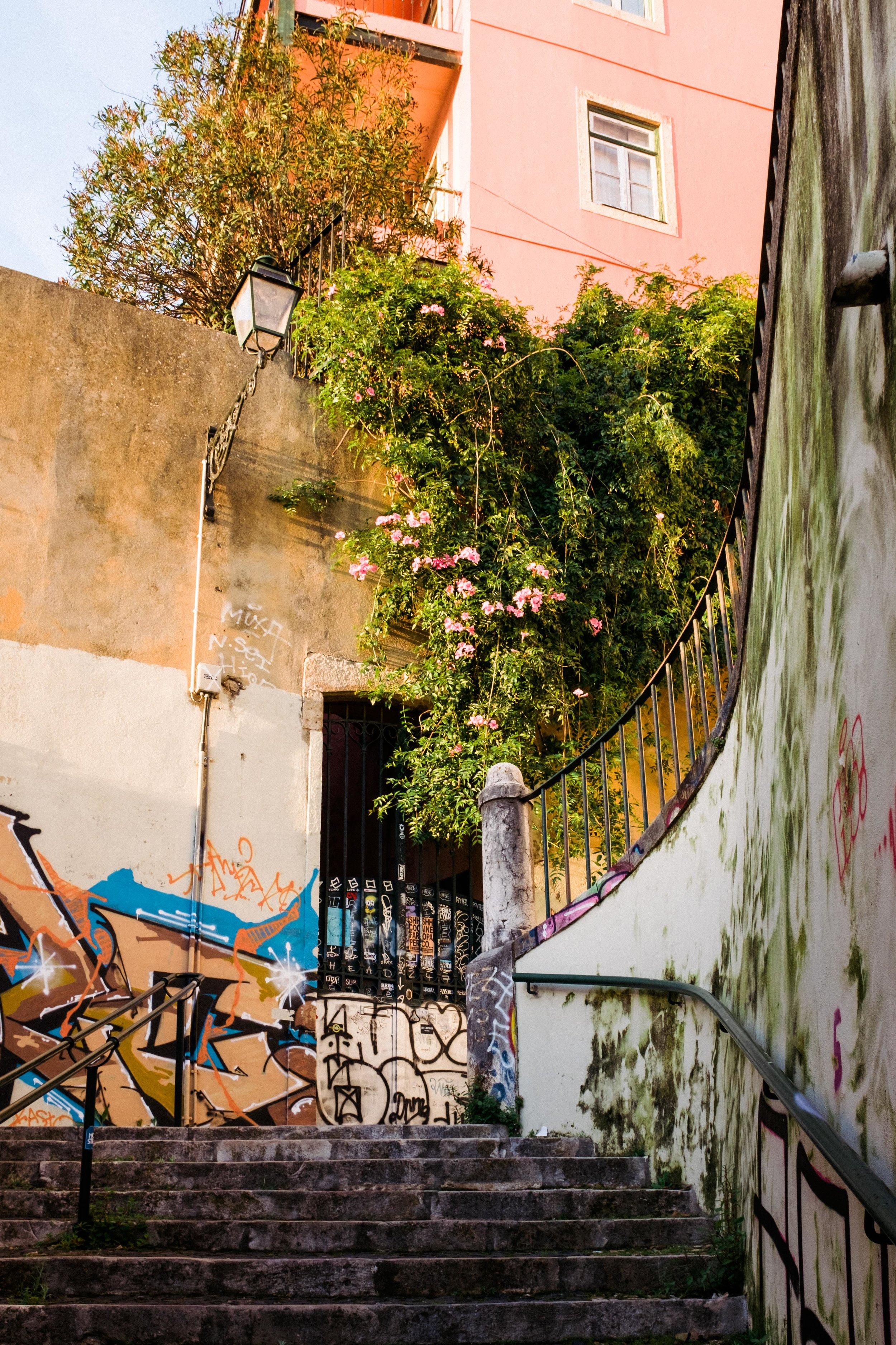 lisbon-portugal-alleyway-stairs-street-art-graffiti