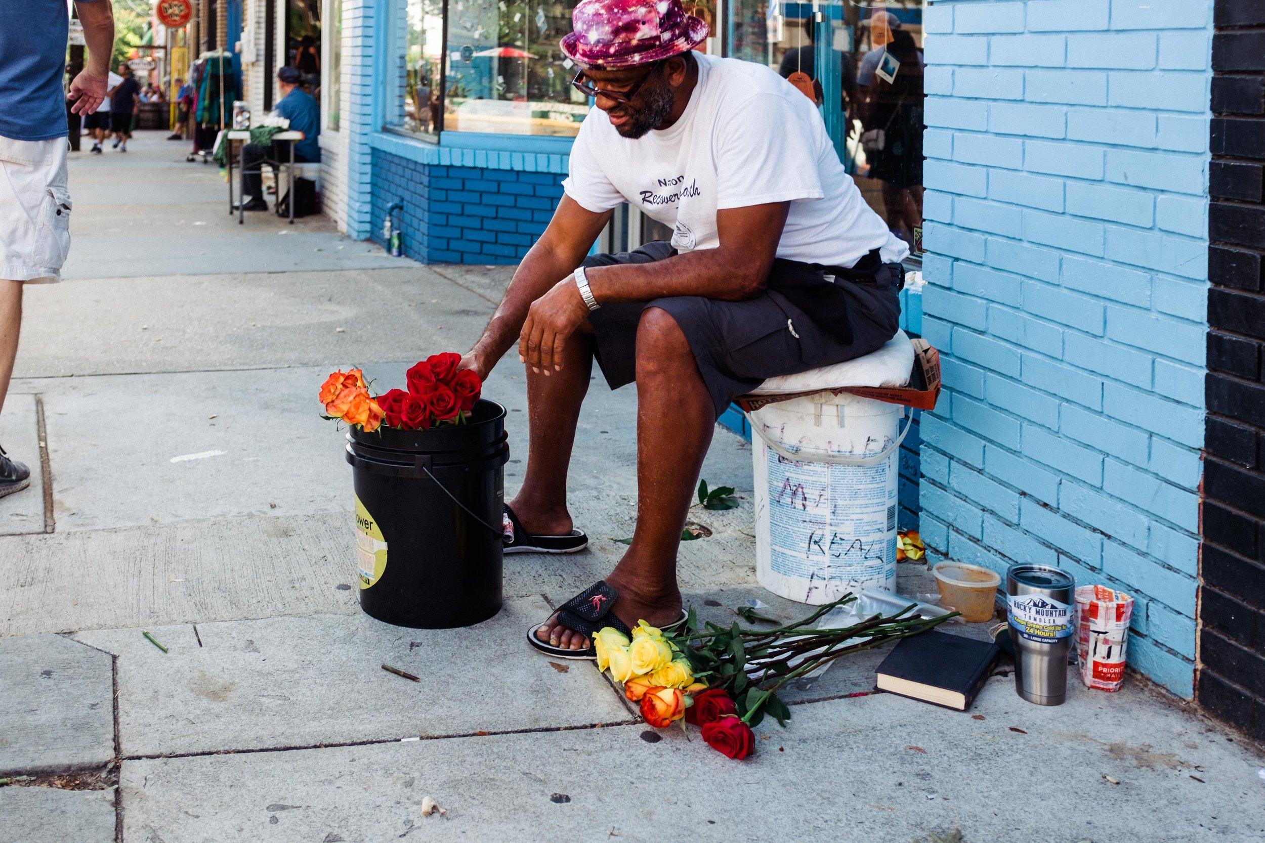atlanta-georgia-little-five-points-man-selling-flowers
