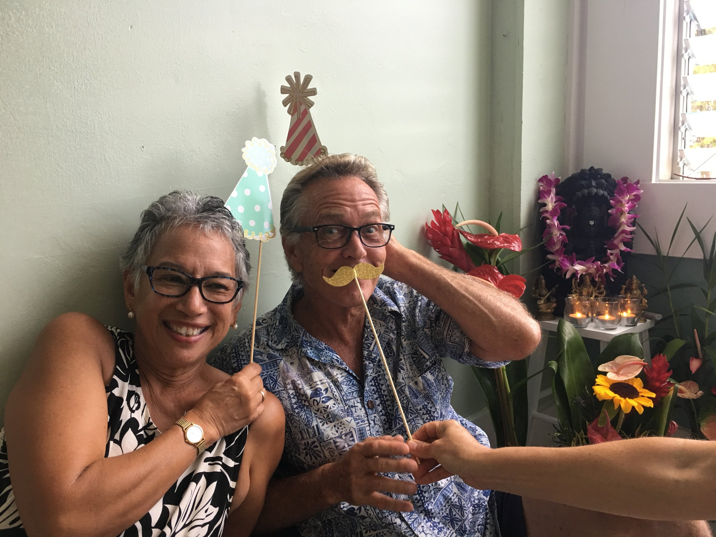 Momi and Mark expressed the value of belonging and community in a center for yoga…and that when life hands you a mustache, best to grin and go with it.