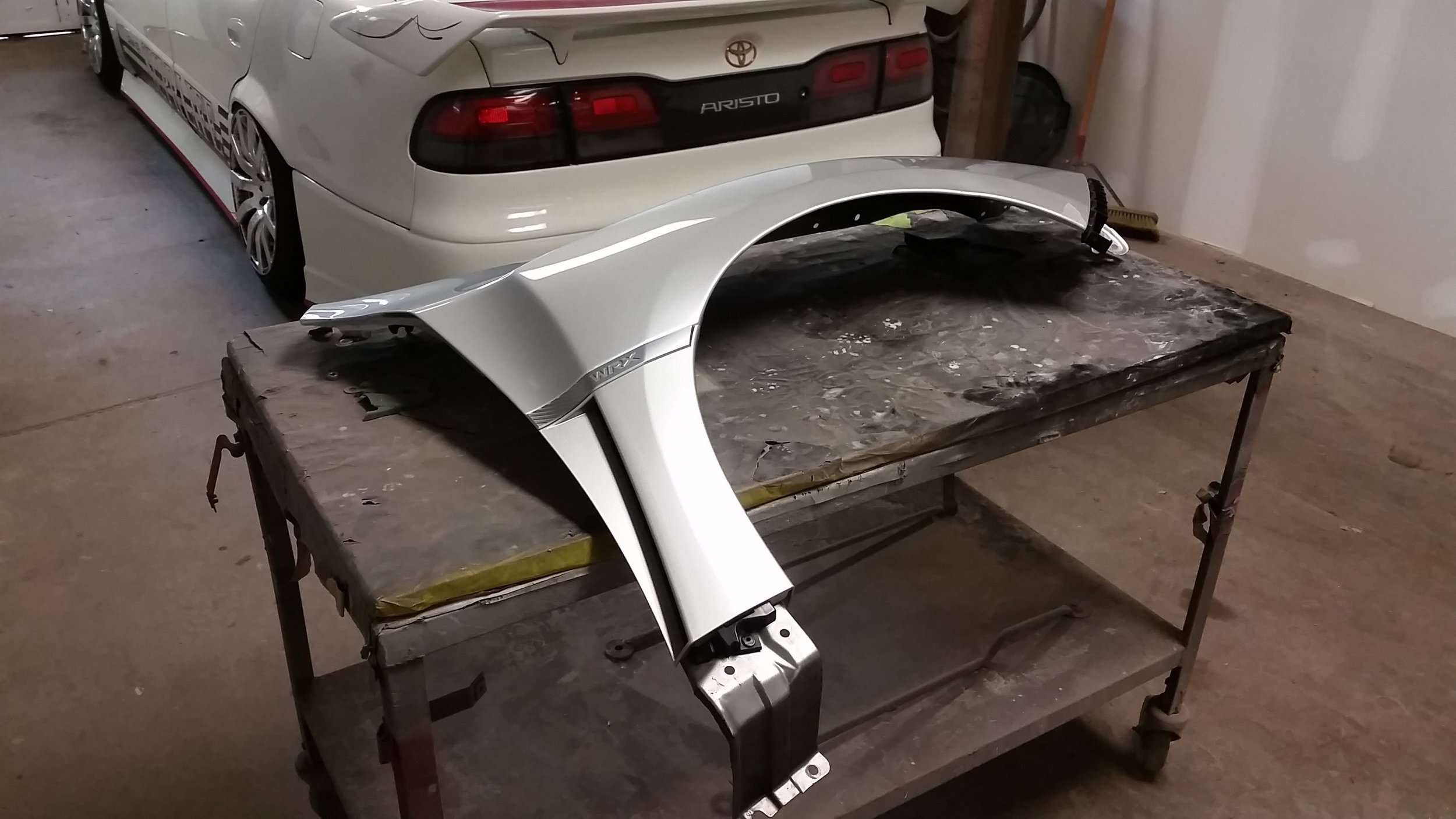 "-stock WRX fender . No plan or design was established prior to work being started. All work was improvised to achieve ""flow""."