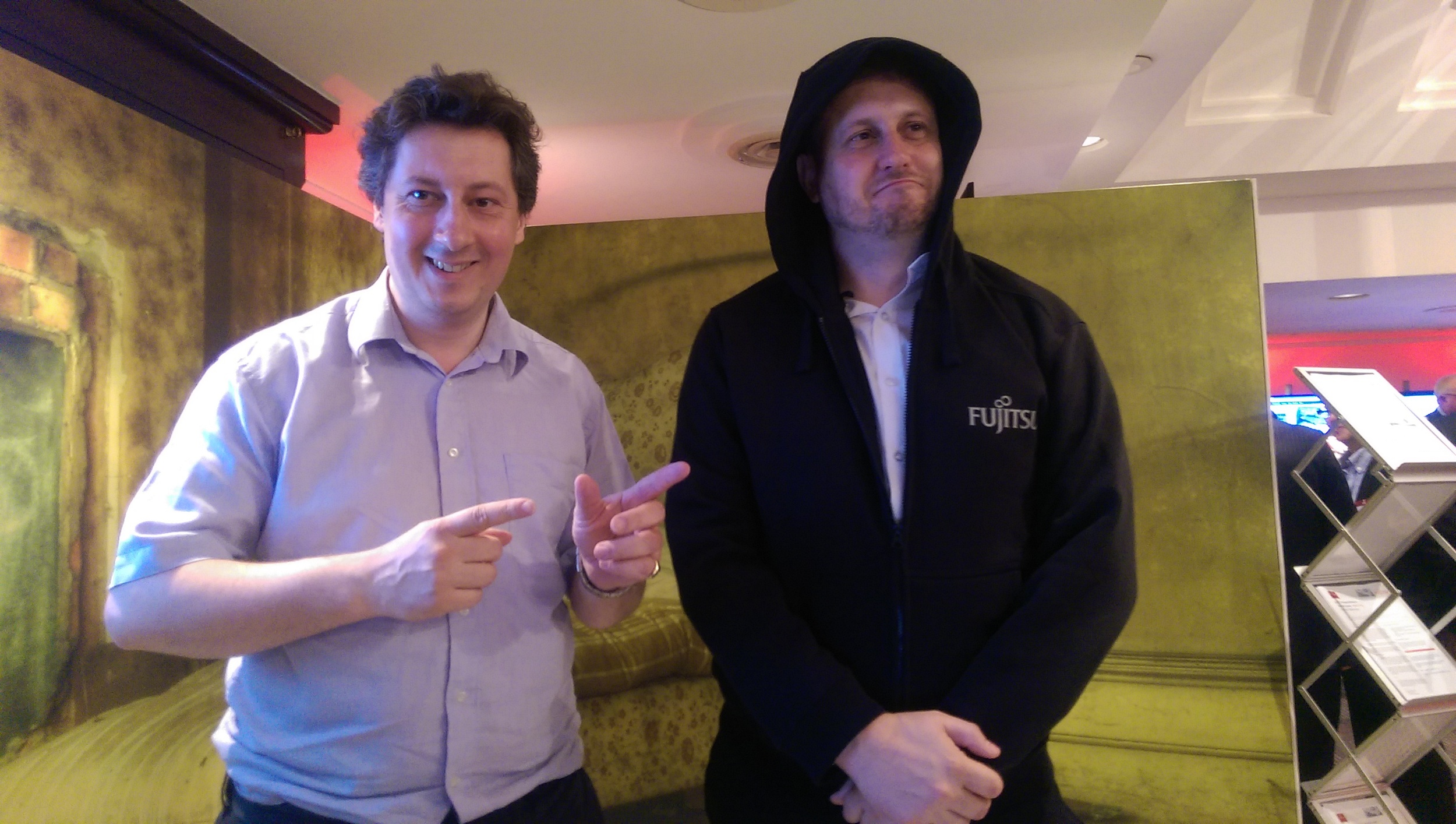 Onega's Ben Fitzgerald with a member of the Fujitsu Hoodie Hacker brigade, who had been released for the day to come and demonstrate their ability to keep your network safe whilst enduring air conducting of the 1812 Overture and other impressivefeats.