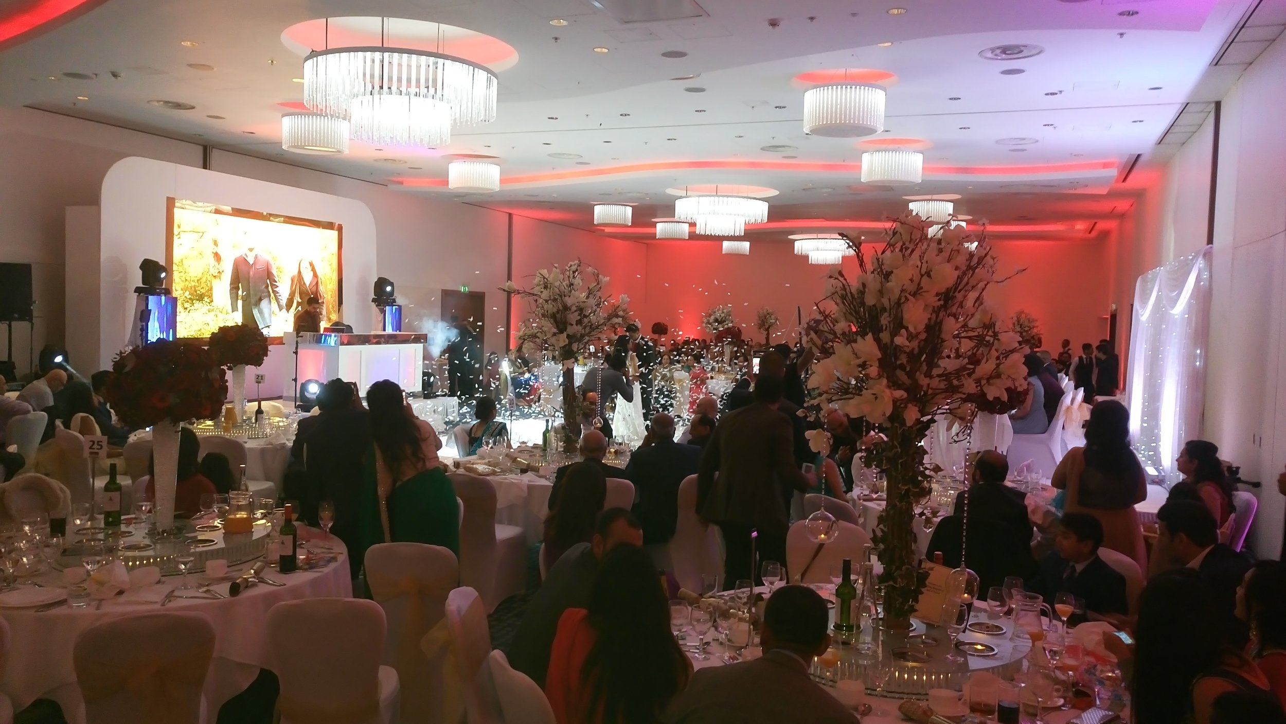 A photo from the big reception and party in the evening. Sejal was changed into a white wedding dress and Krunal wore a dinner suit and top hat - you can see the dancing in the centre of the picture here amongst the confetti.