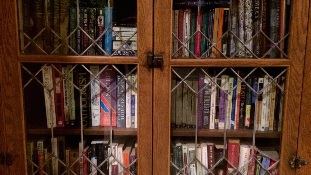 One of our many bookshelves at home. September, 2015. Photo by me.