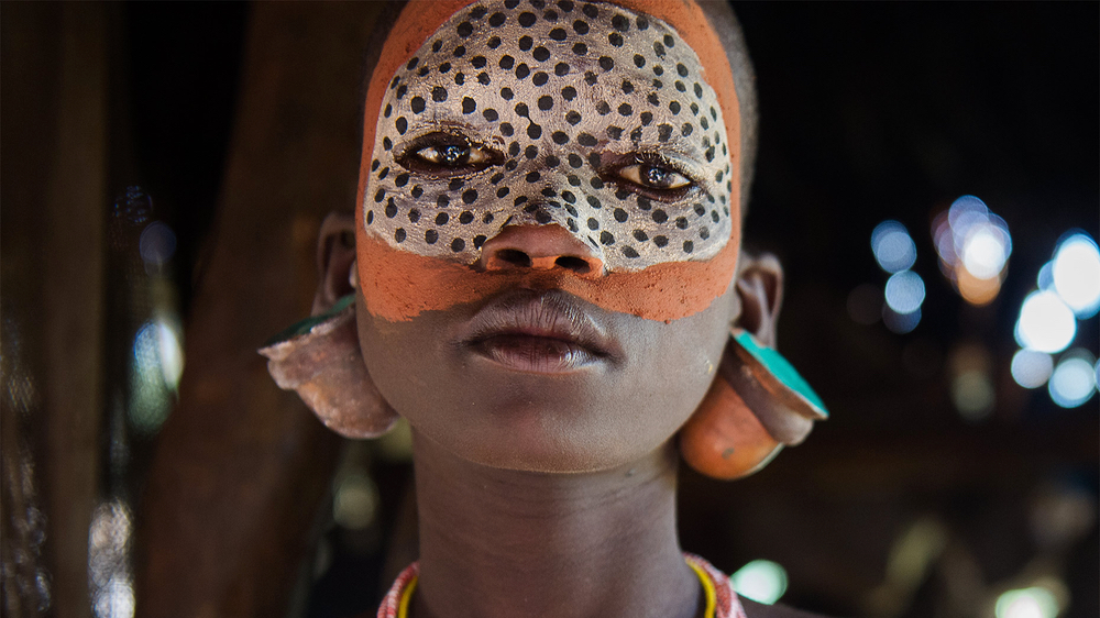 Suri Tribe face paint, Omo Valley. From Vanishing World Photography. 2010.