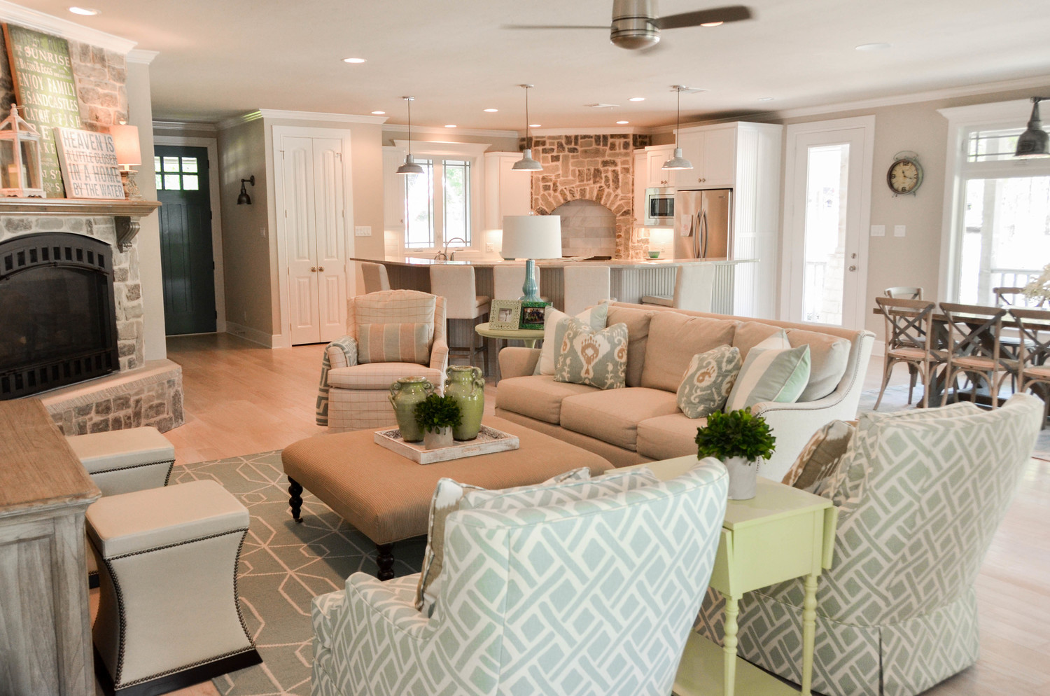Casual farmhouse country interior design. Open concept lake house design.