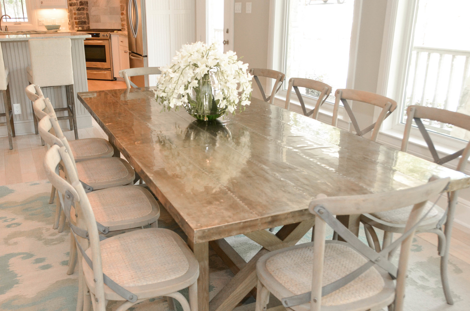 Metal top dining table. Zinc top dining table. Farmhouse dining table. X-back rush seat dining chairs