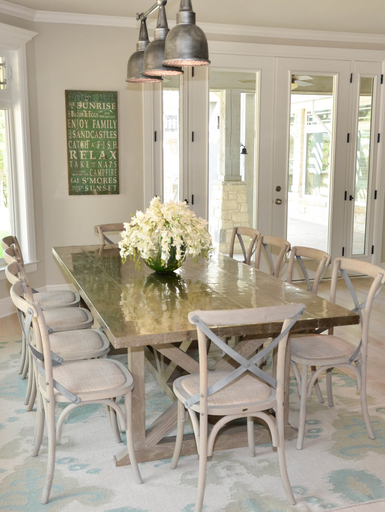 Metal top dining table. Zinc top dining table. Farmhouse dining table. X-back rush seat dining chairs. Flame stitch flat weave rug.