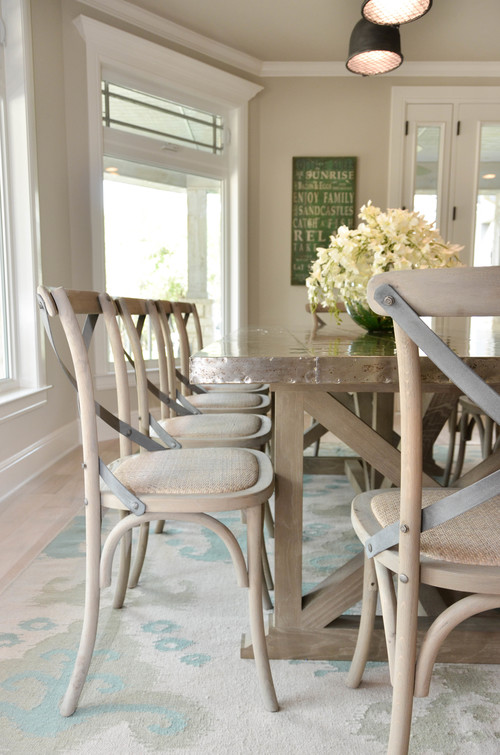 Metal top dining table. Zinc top taupe dining table. Farmhouse dining table. X-back rush seat dining chairs. Flame stitch flat weave rug.