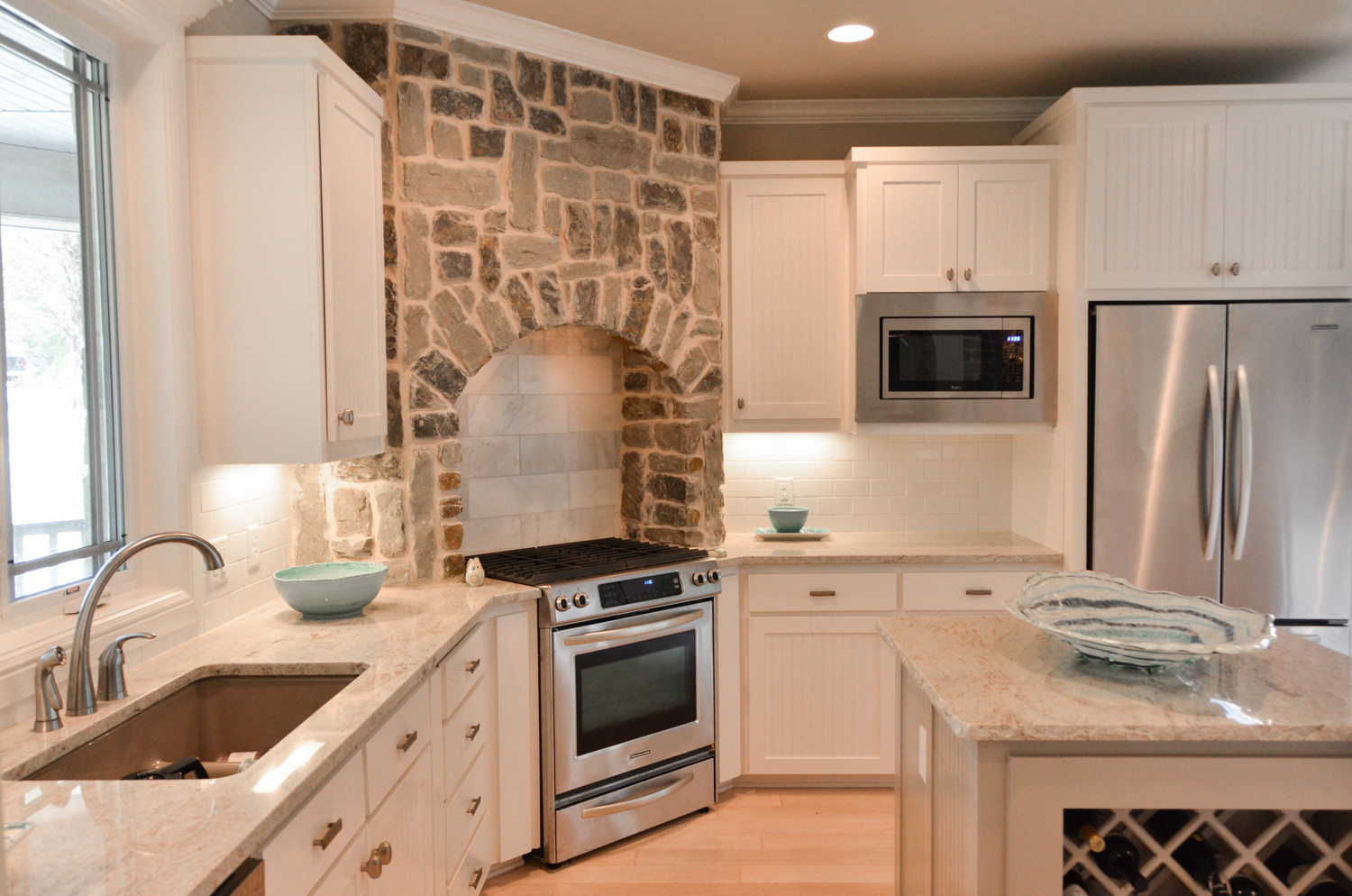 High end custom farmhouse kitchen. Granite counter tops with an island.