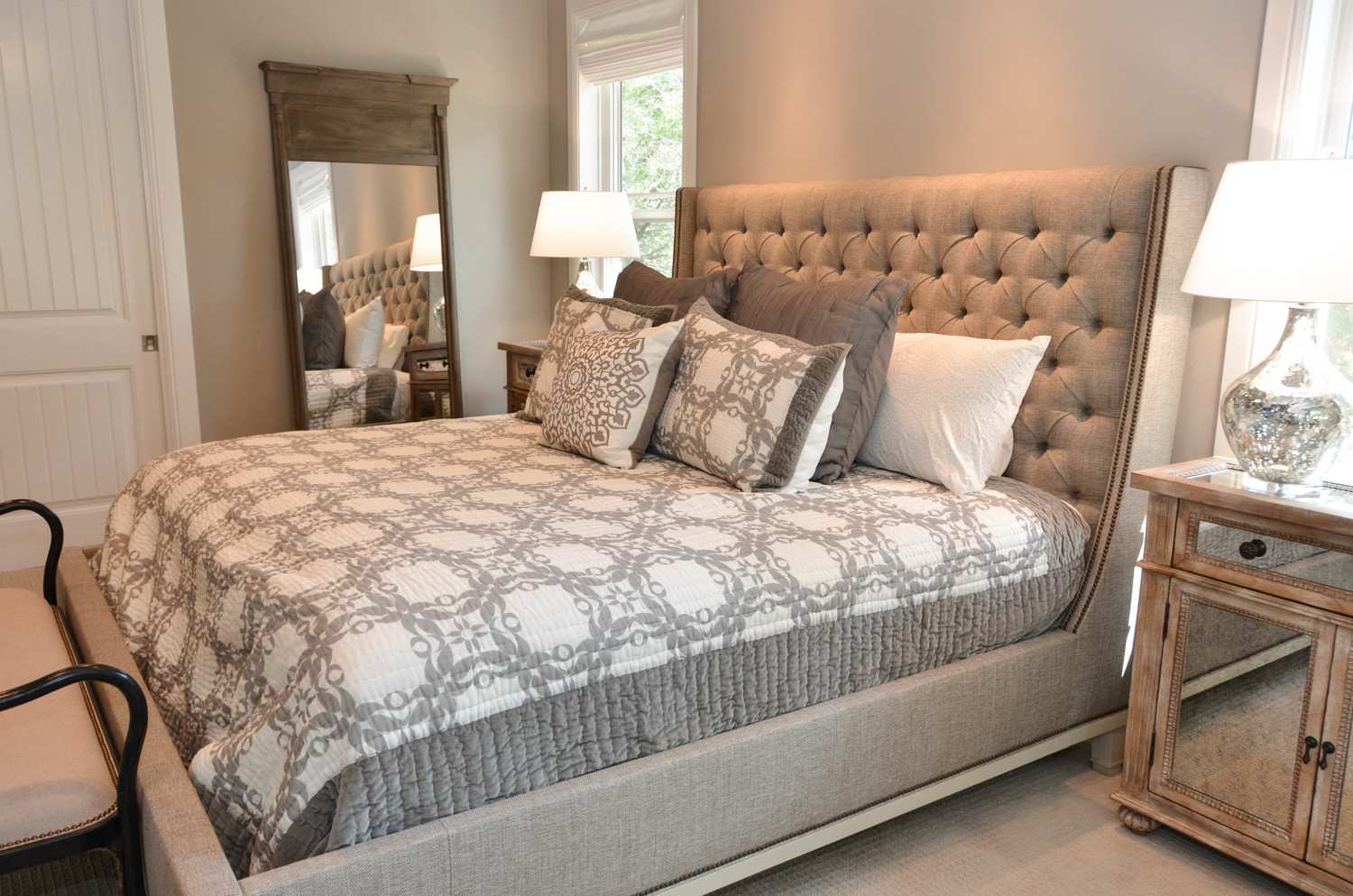 Layered neutrals in a master bedroom retreat. Featuring a taupe Vanguard Cleo tufted bed