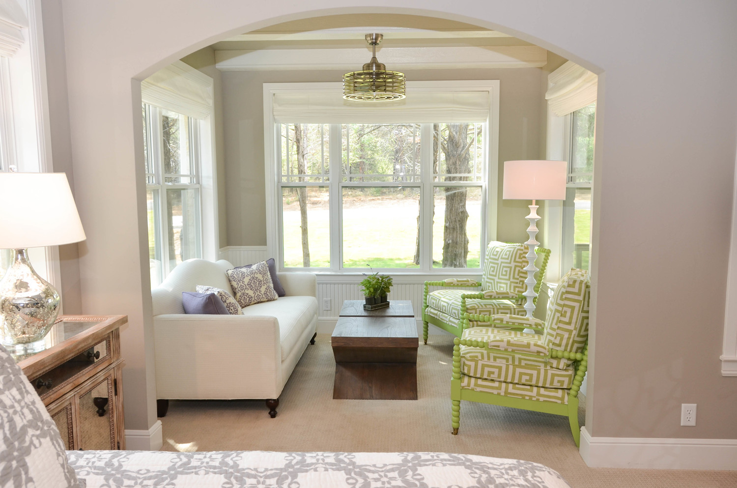 Lime green chairs. Purple and green. Turned wood chairs. Modern farmhouse sunroom design.