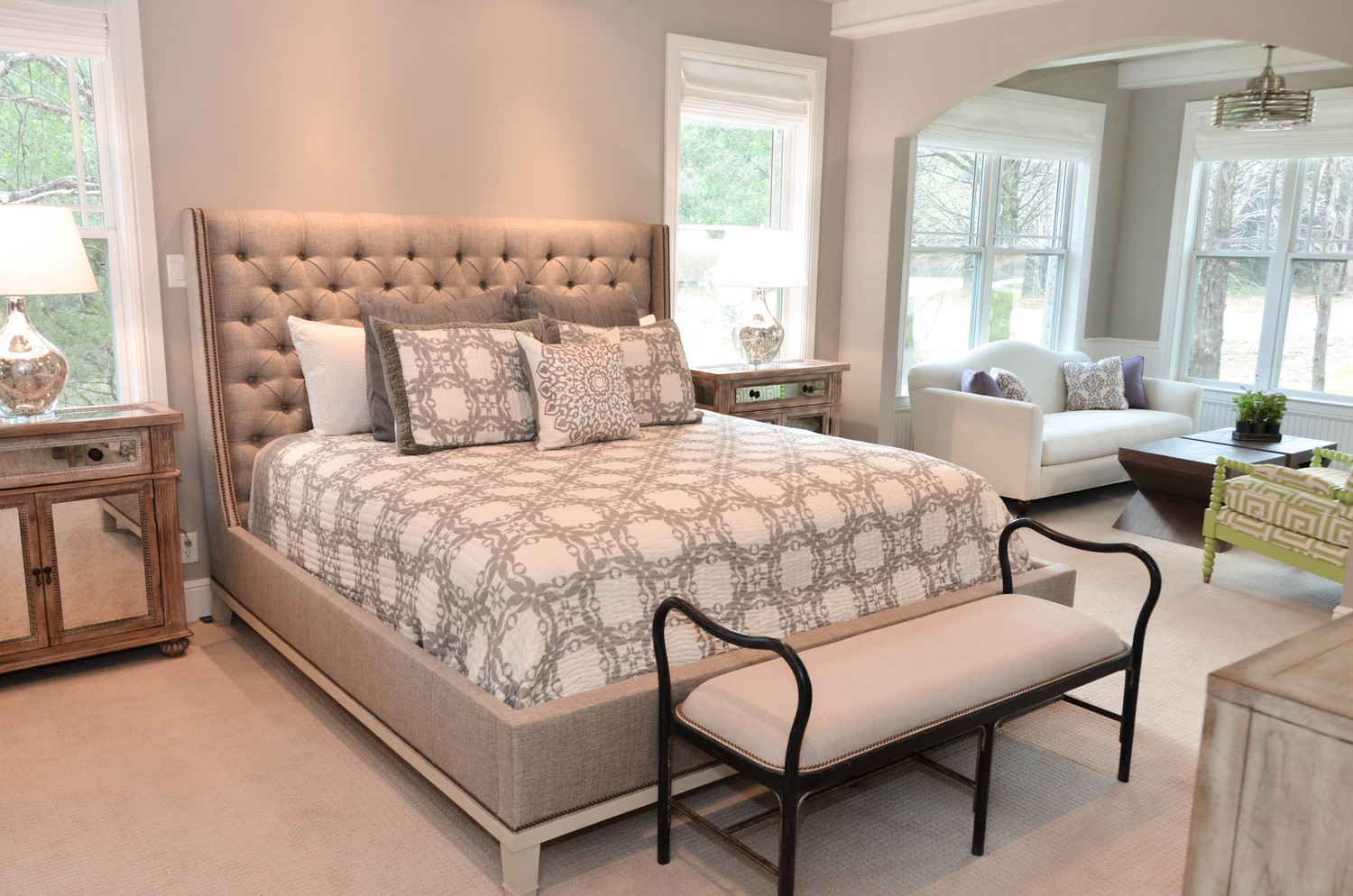 Vanguard Cleo bed. Grey tufted headboard with mirrored night stands. Country design.