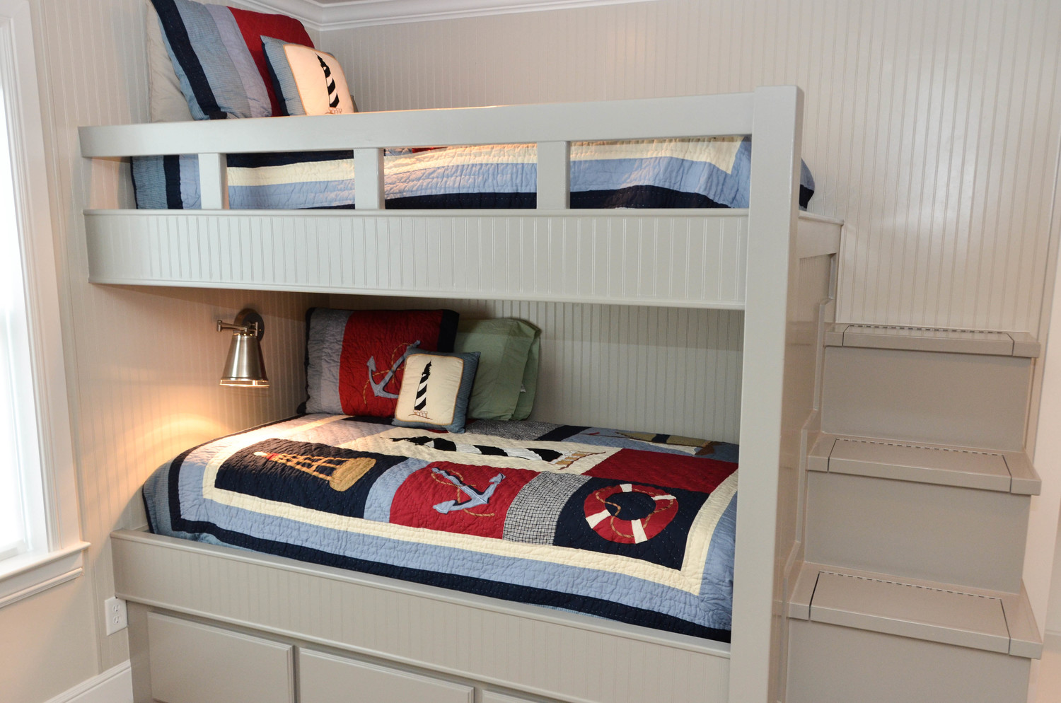 Build in bunk bed room at a lake house vacation home. Boat themed guest bedroom