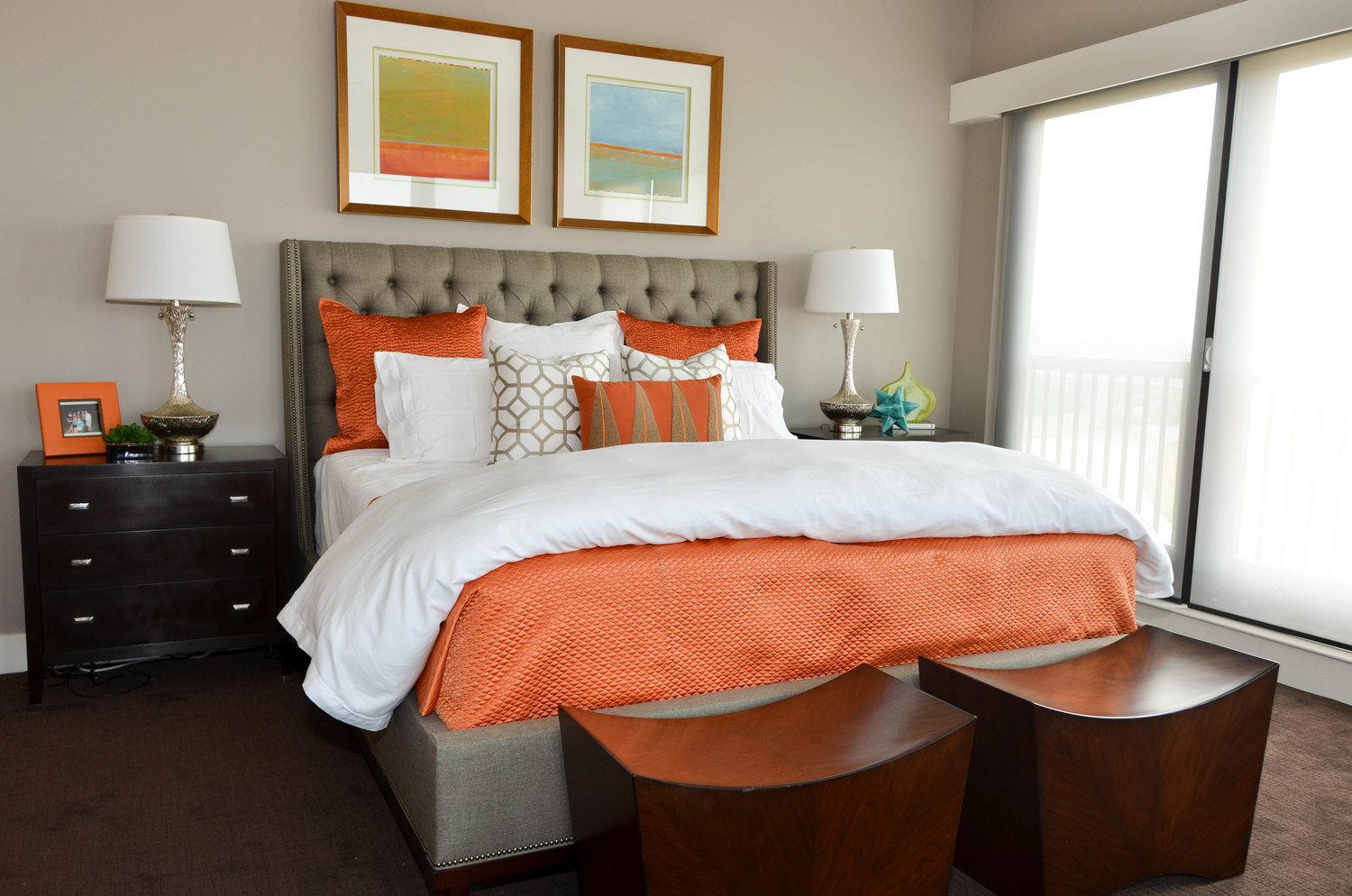 Transitional master bedroom with orange color