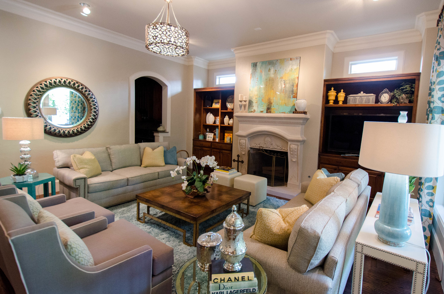 Teal and yellow transitional family room