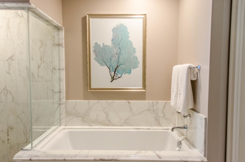 Turquoise coral art above bathtub