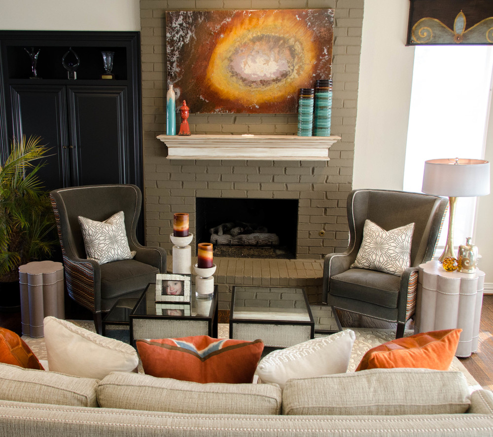 Gray painted bring fireplace with pops of color