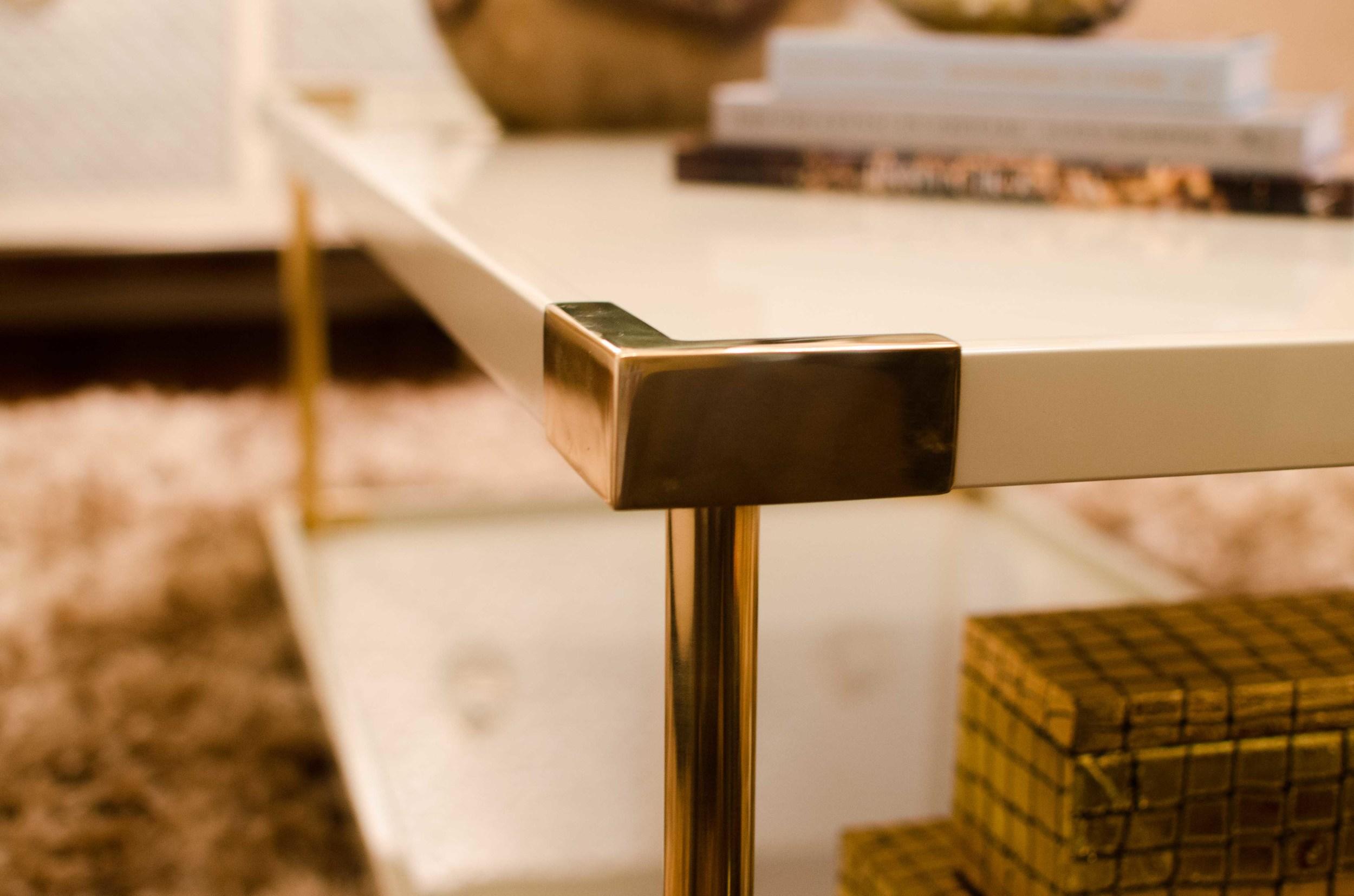 Brass details on modern furniture