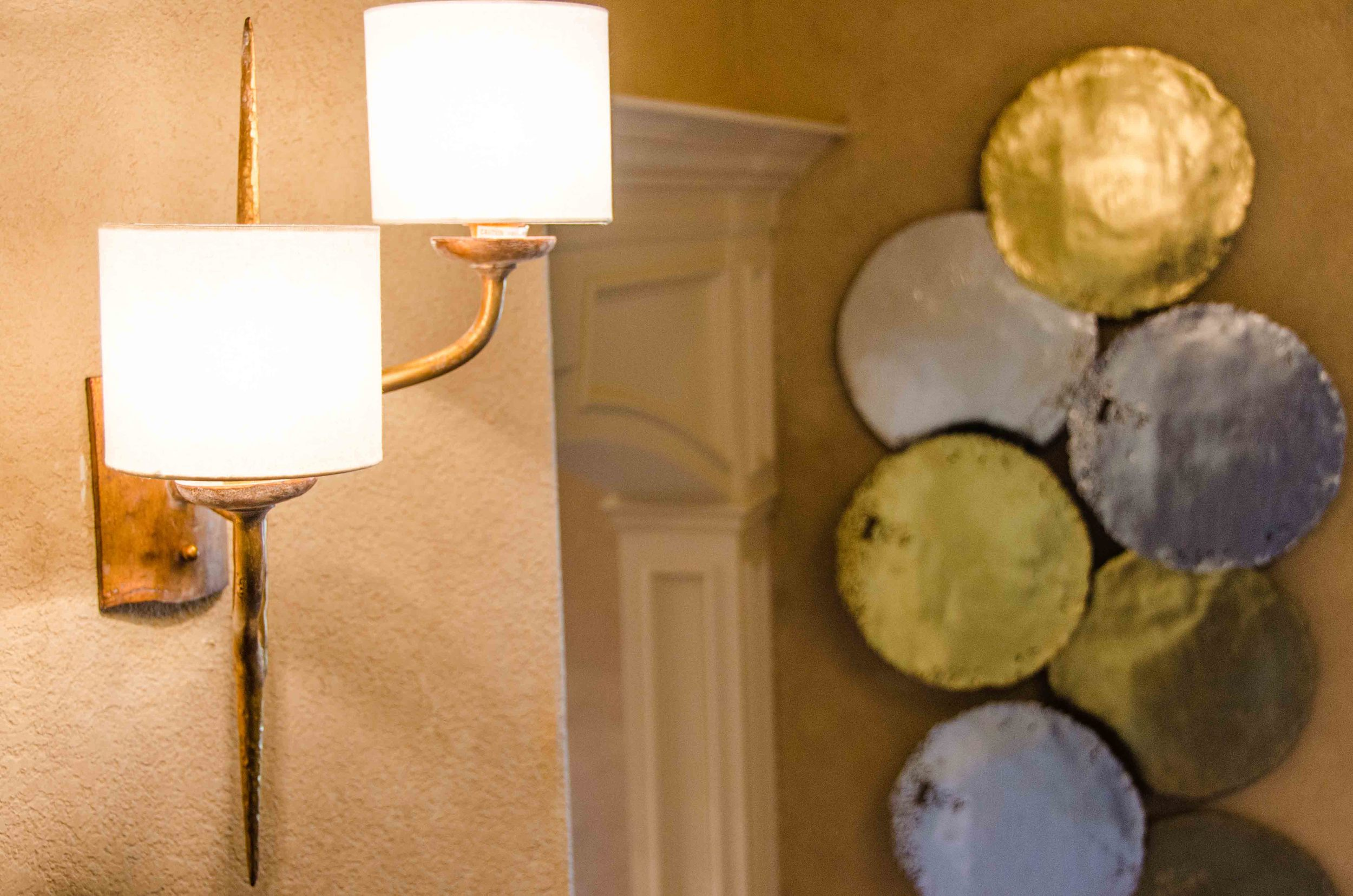 Brass wall sconce and mixed metals