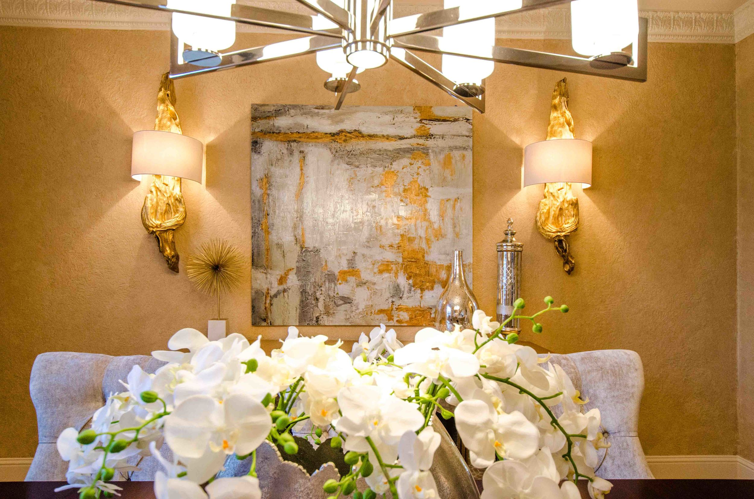 Metallic gold abstract art and gold wood wall sconces