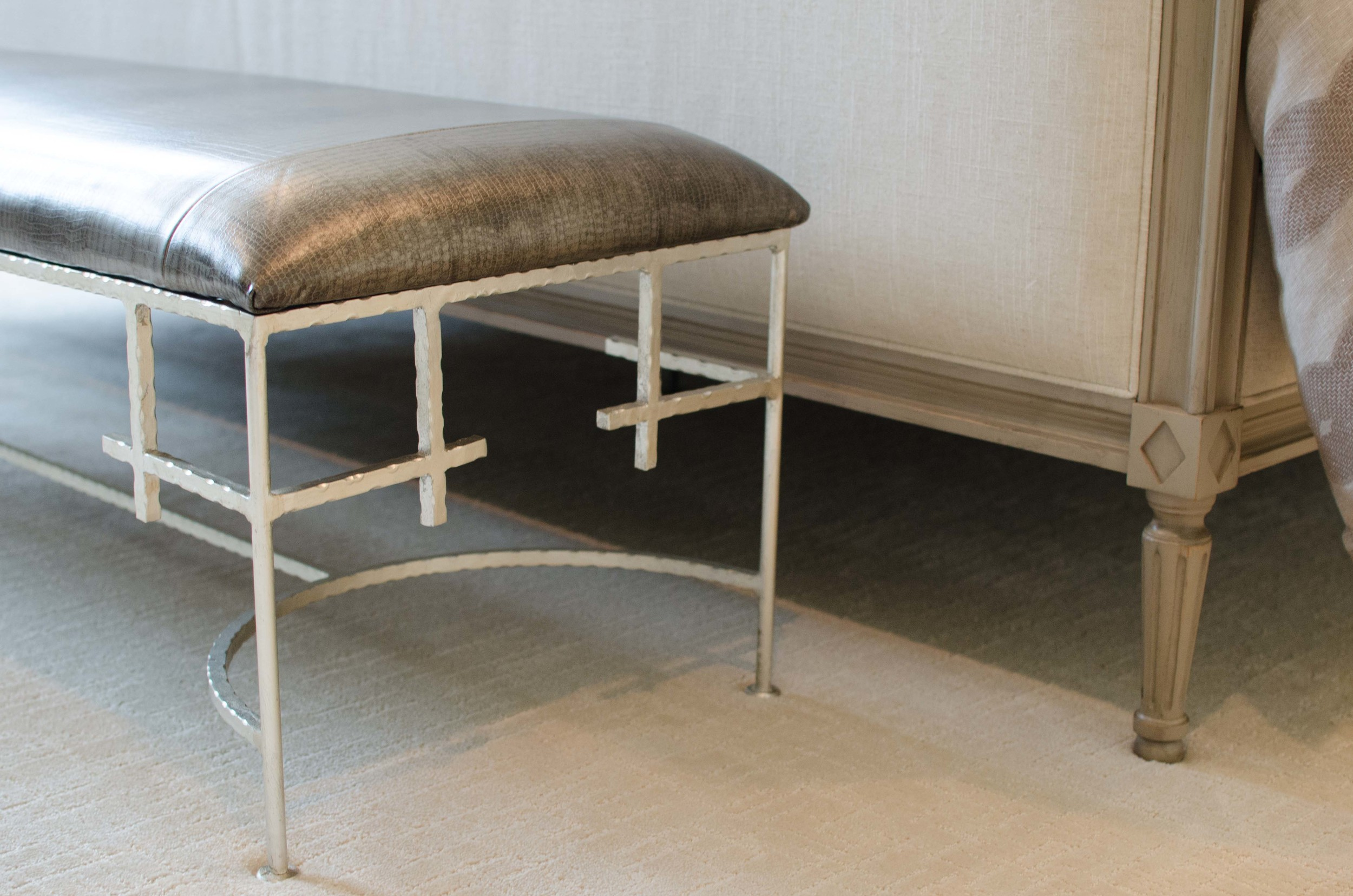 Modern bench at the foot of a bed