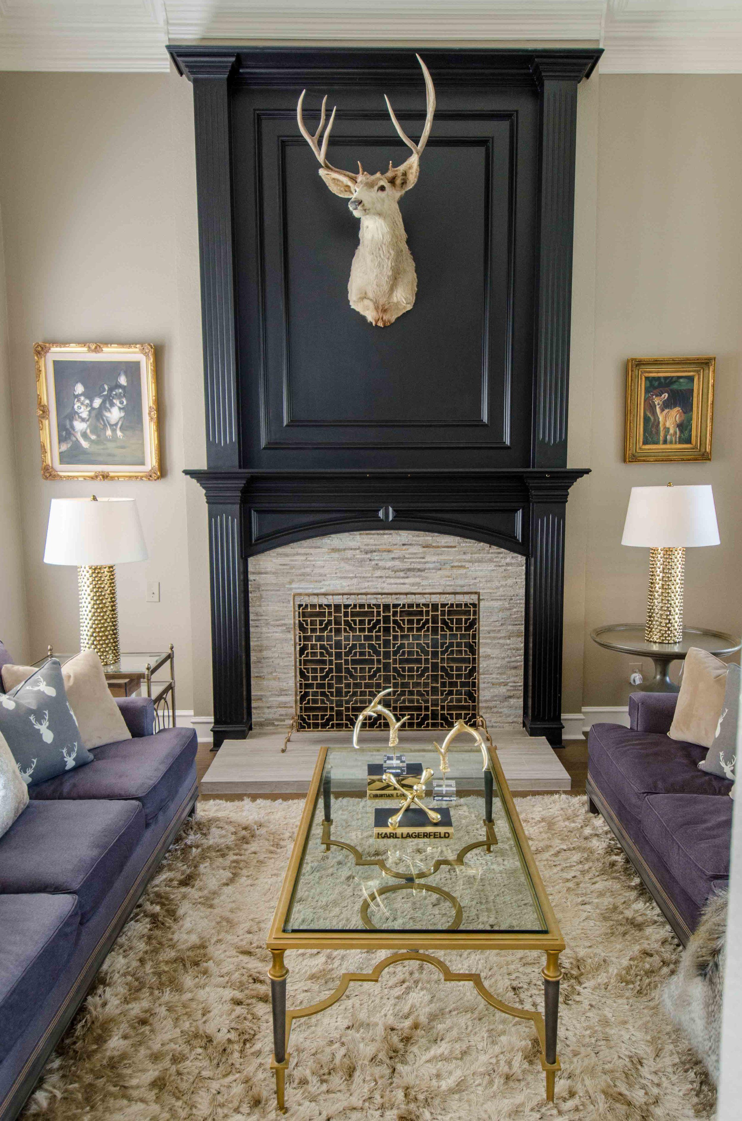 Symmetrical twin charcoal sofas