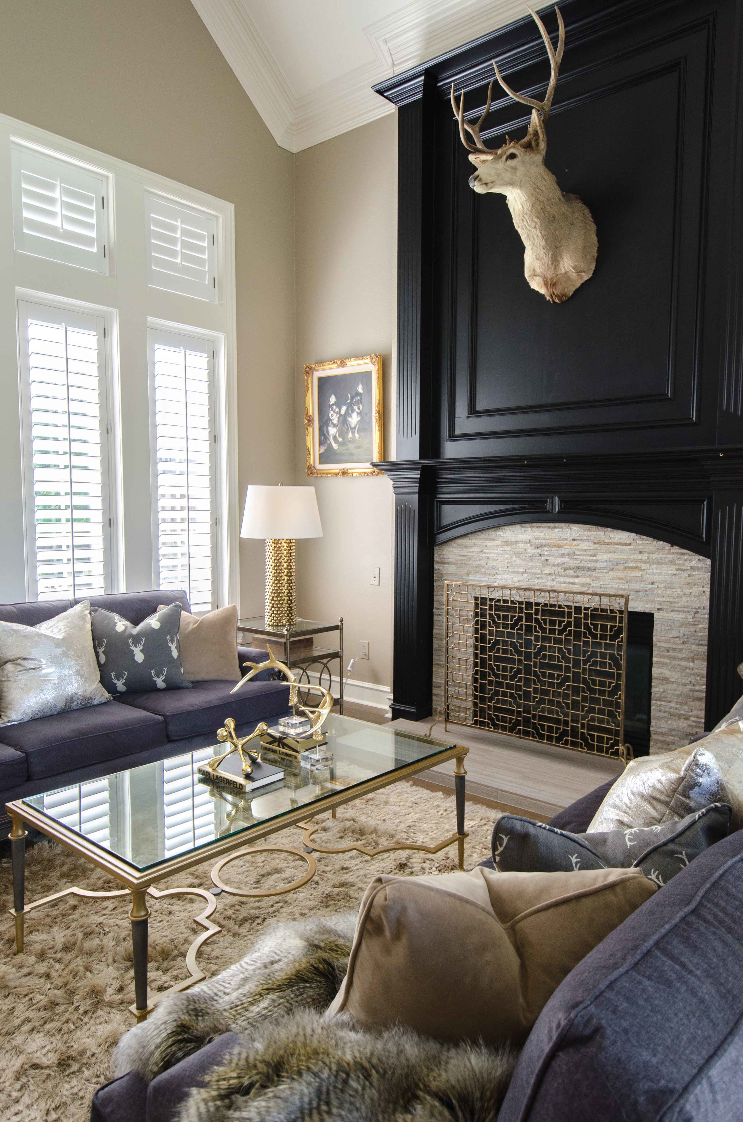 Updated black painted fireplace in a formal living room