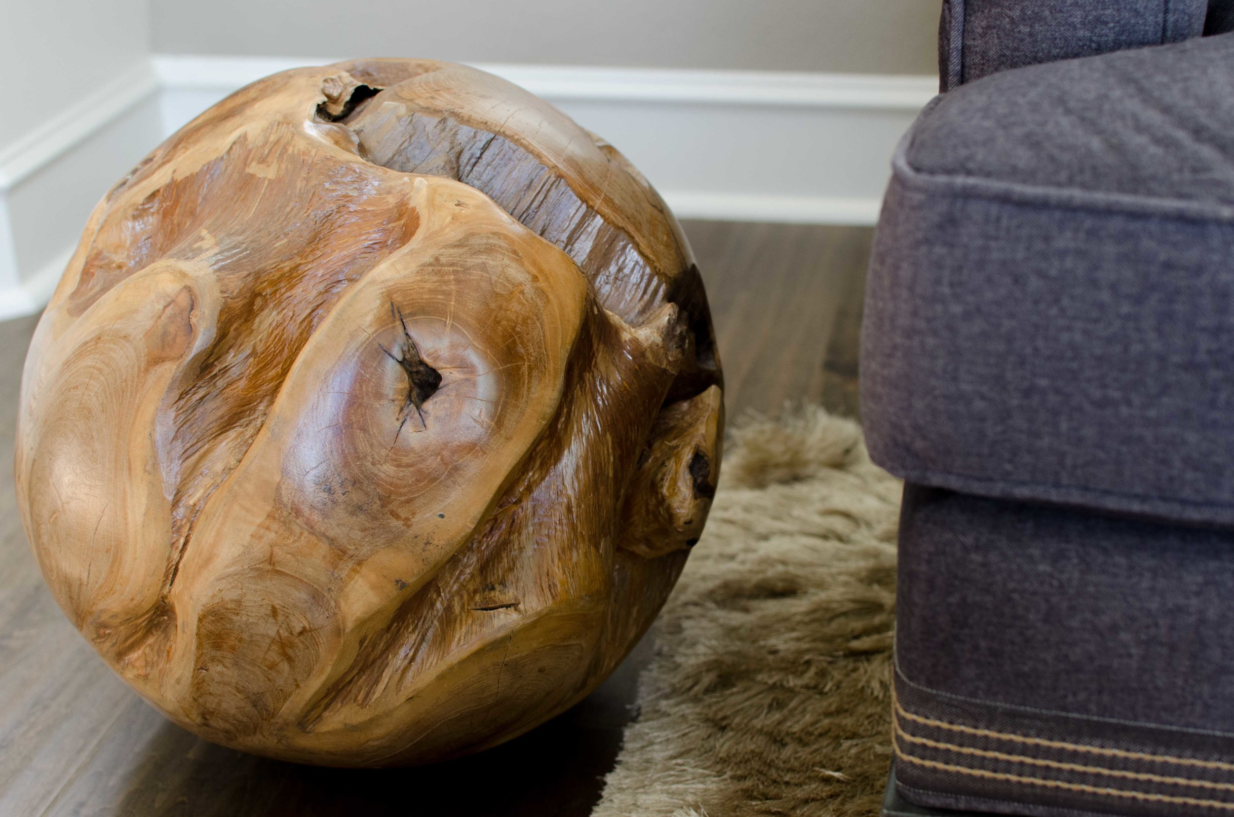 Wood ball sculpture and contrasting tape on sofa base