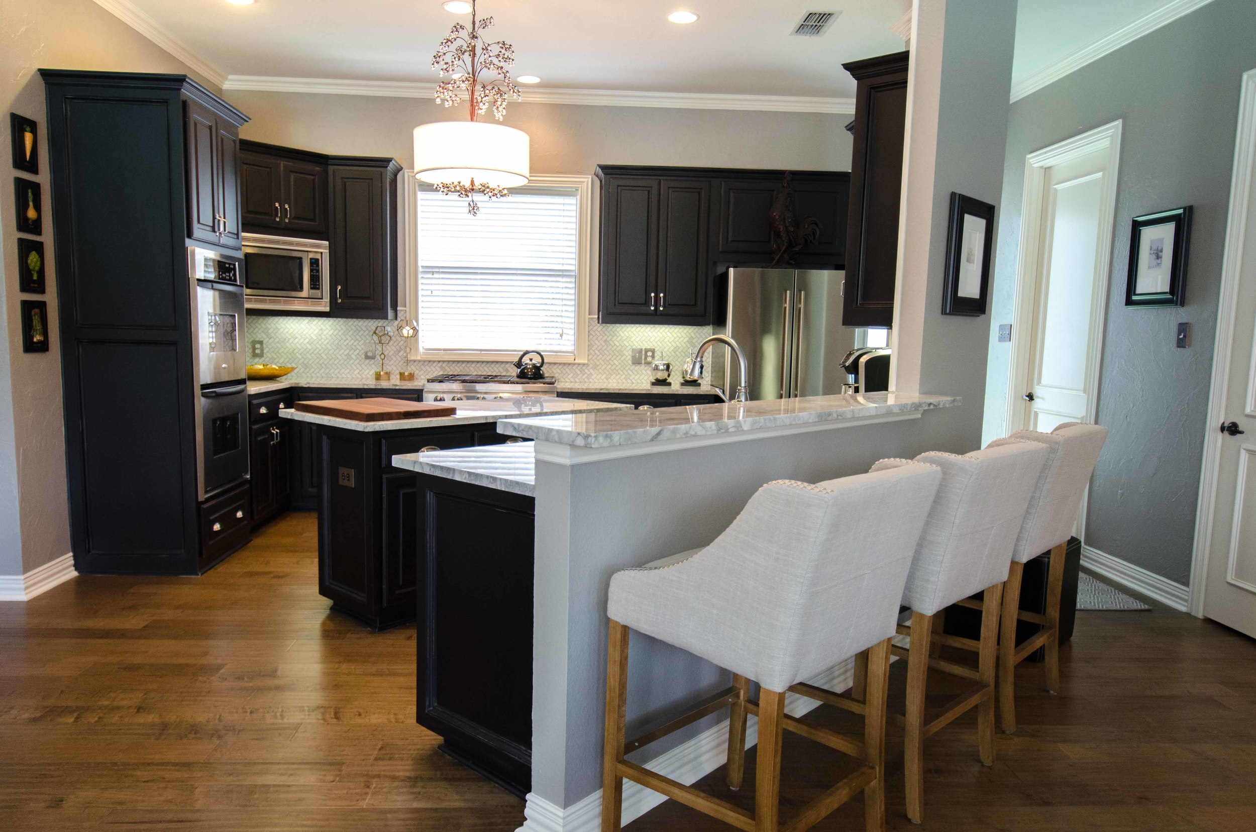 Linen bar stools in a black cabinet kitchen