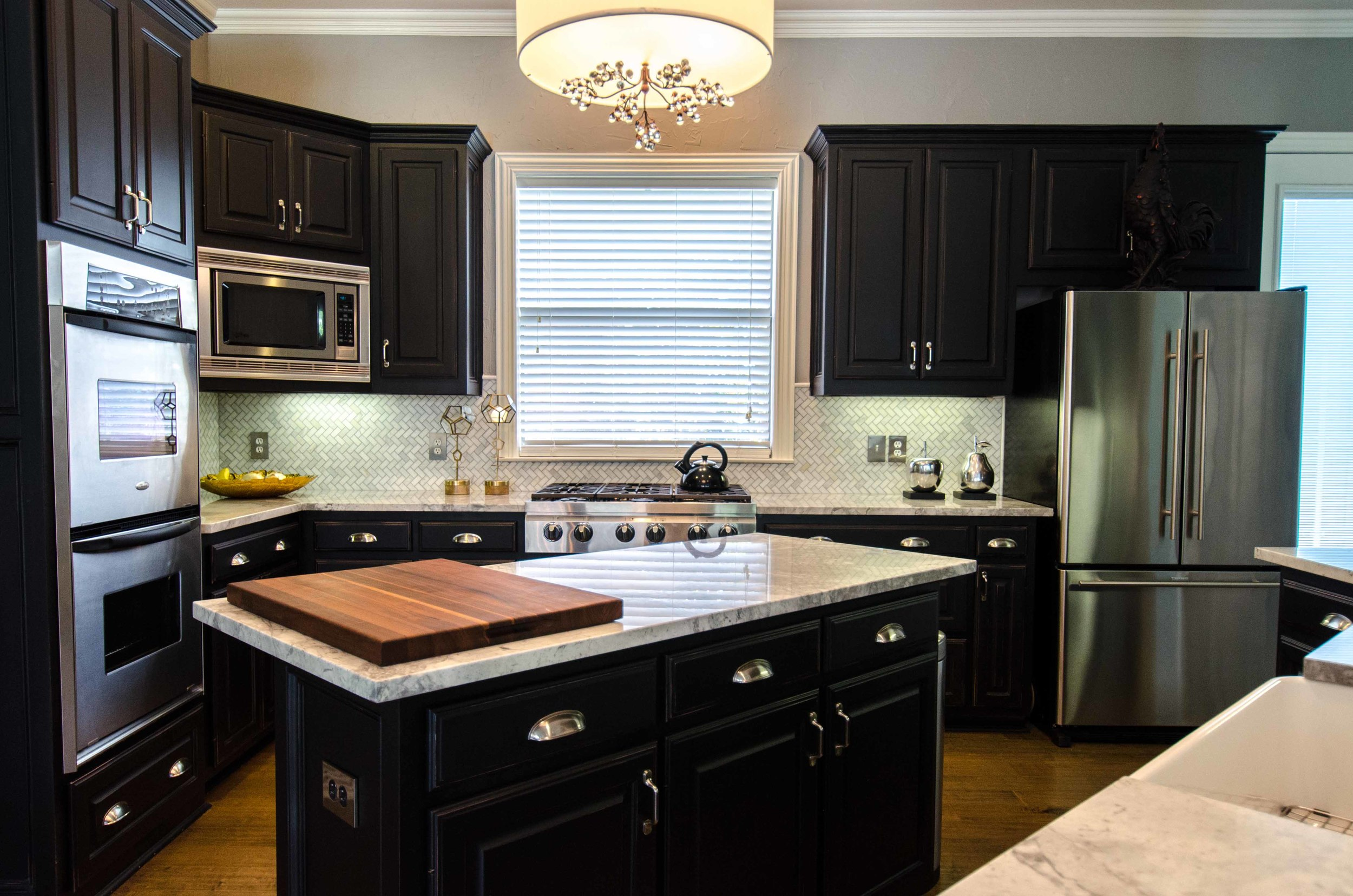 Traditional classic kitchen with window above sink