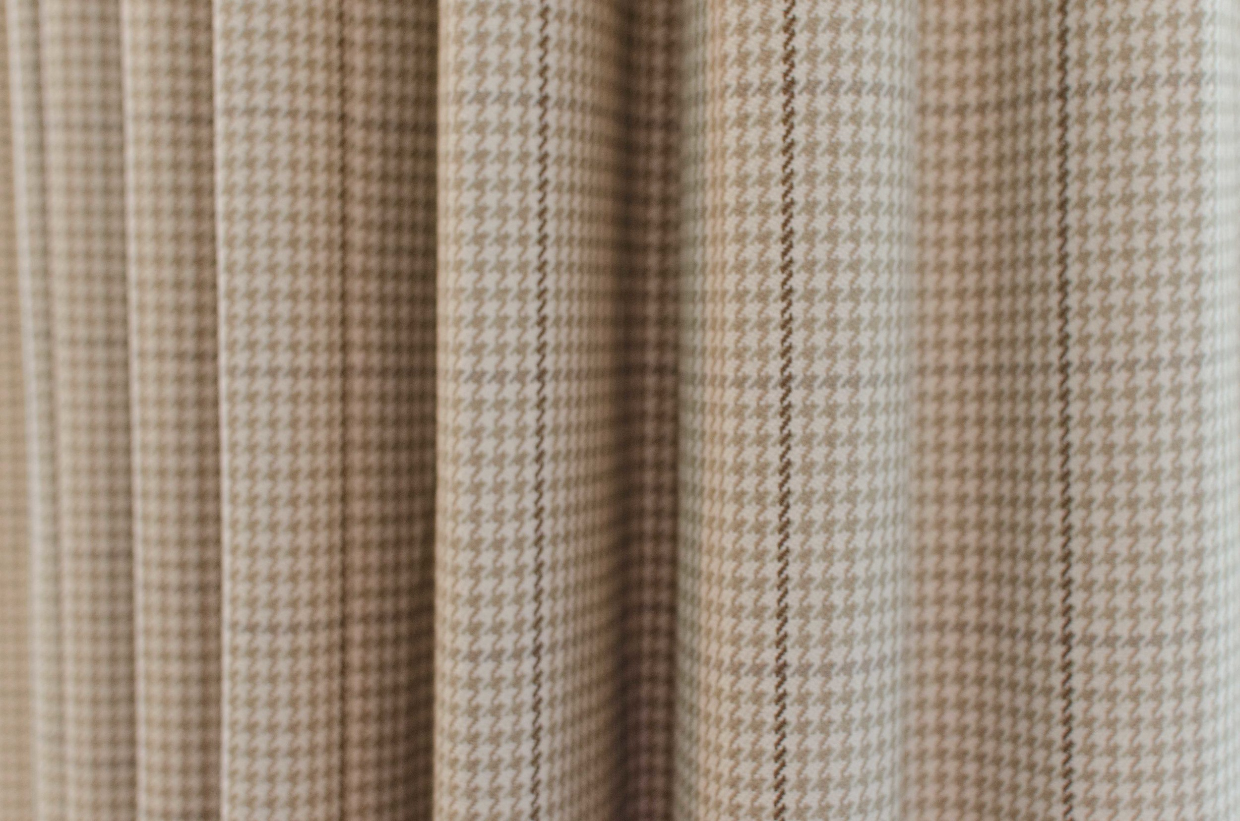 Classic tan houndstooth check fabric pattern