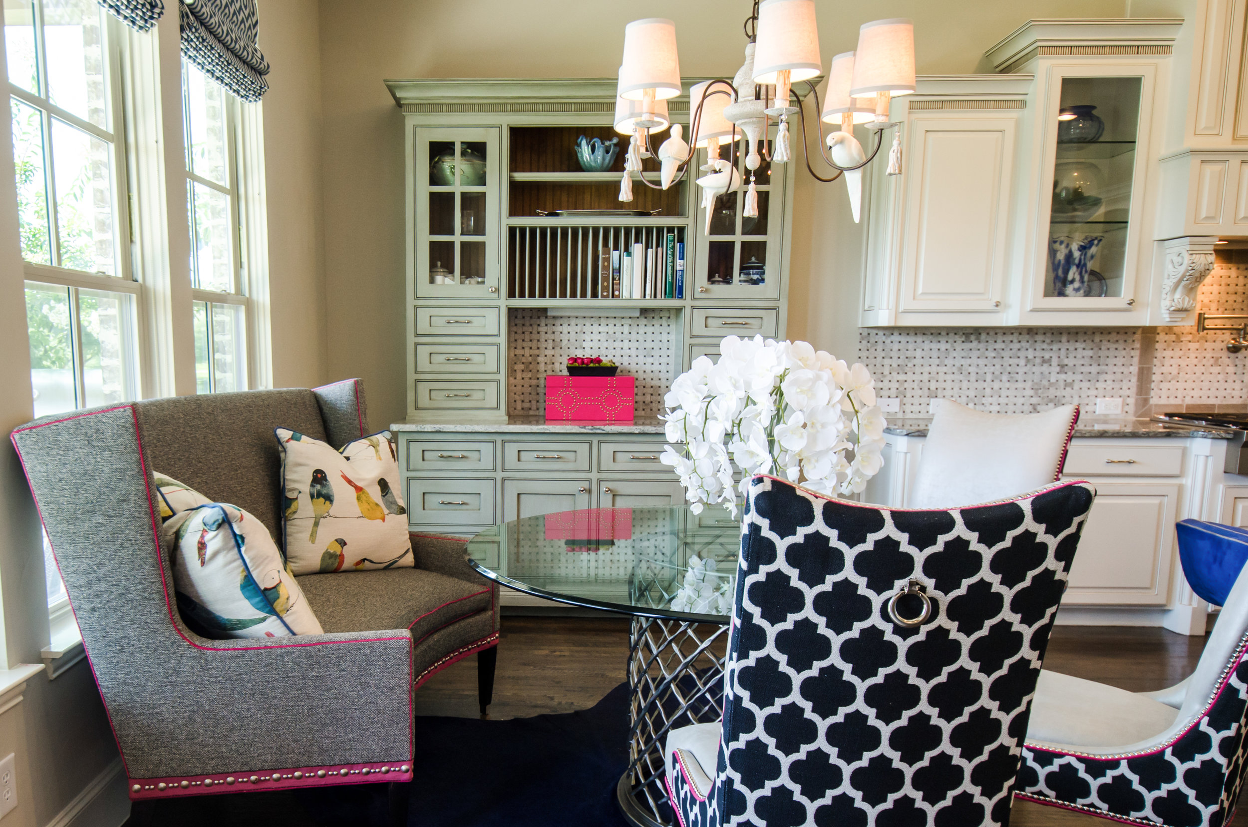 Using a whimsical bird print pillows and chandelier in my client's home. McKinney, Texas