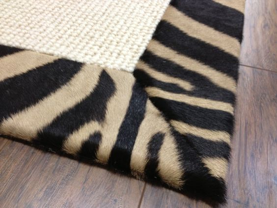 Just a touch of animal in a room can be understated with a simple banding around a sisal rug.