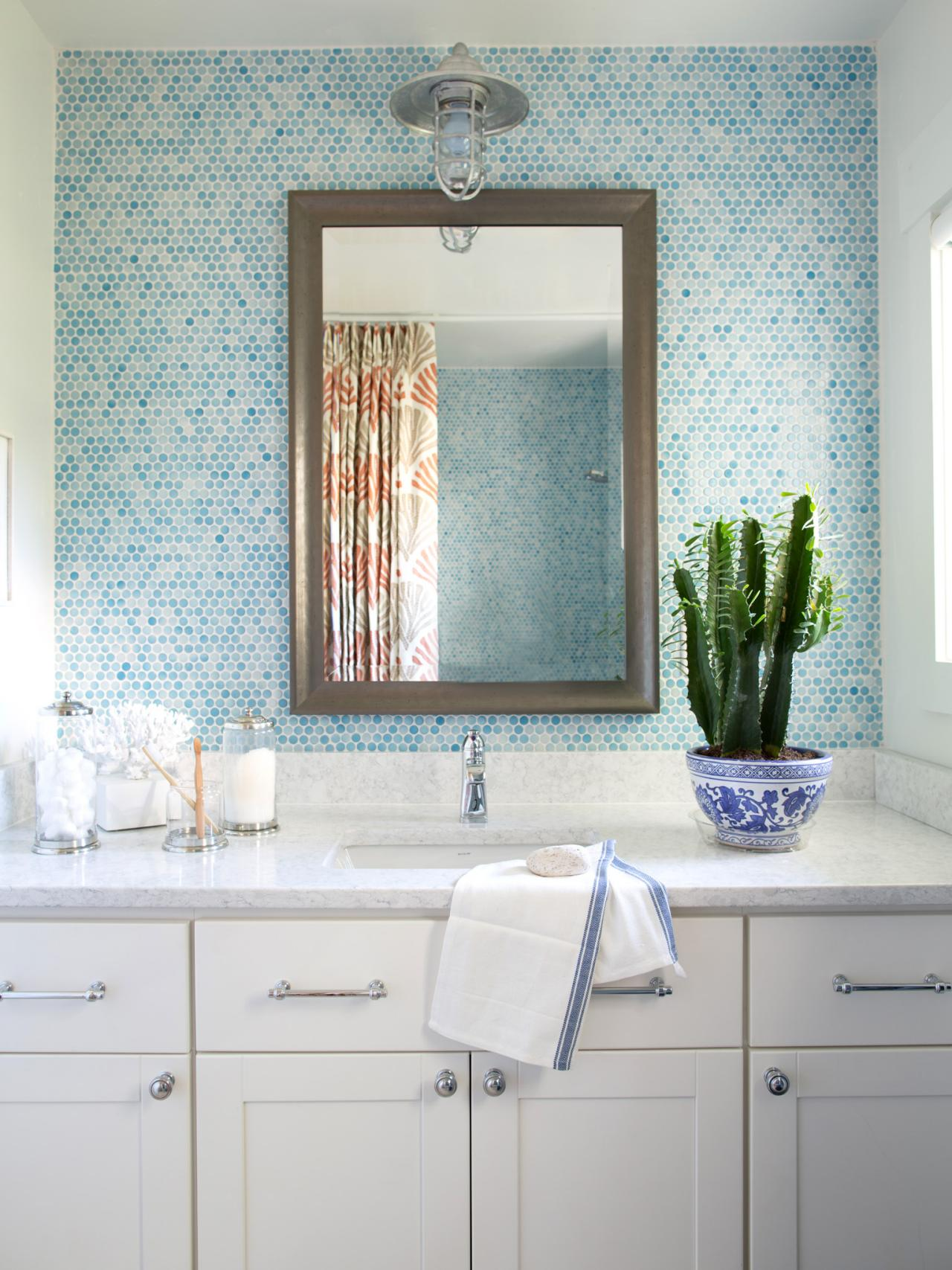 Having fun with a wall of accent tile in a bathroom brings so much style to your home.