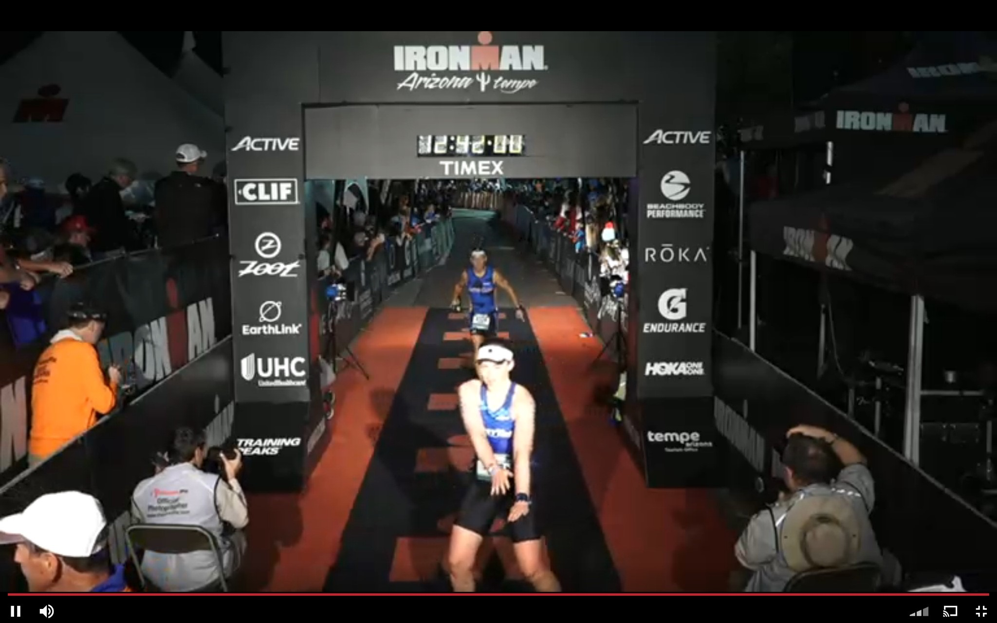 Me showing off my dance moves as I cross the finish line!  Not only did I complete the Ironman Arizona, I did it in a personal best sub 13 hours!