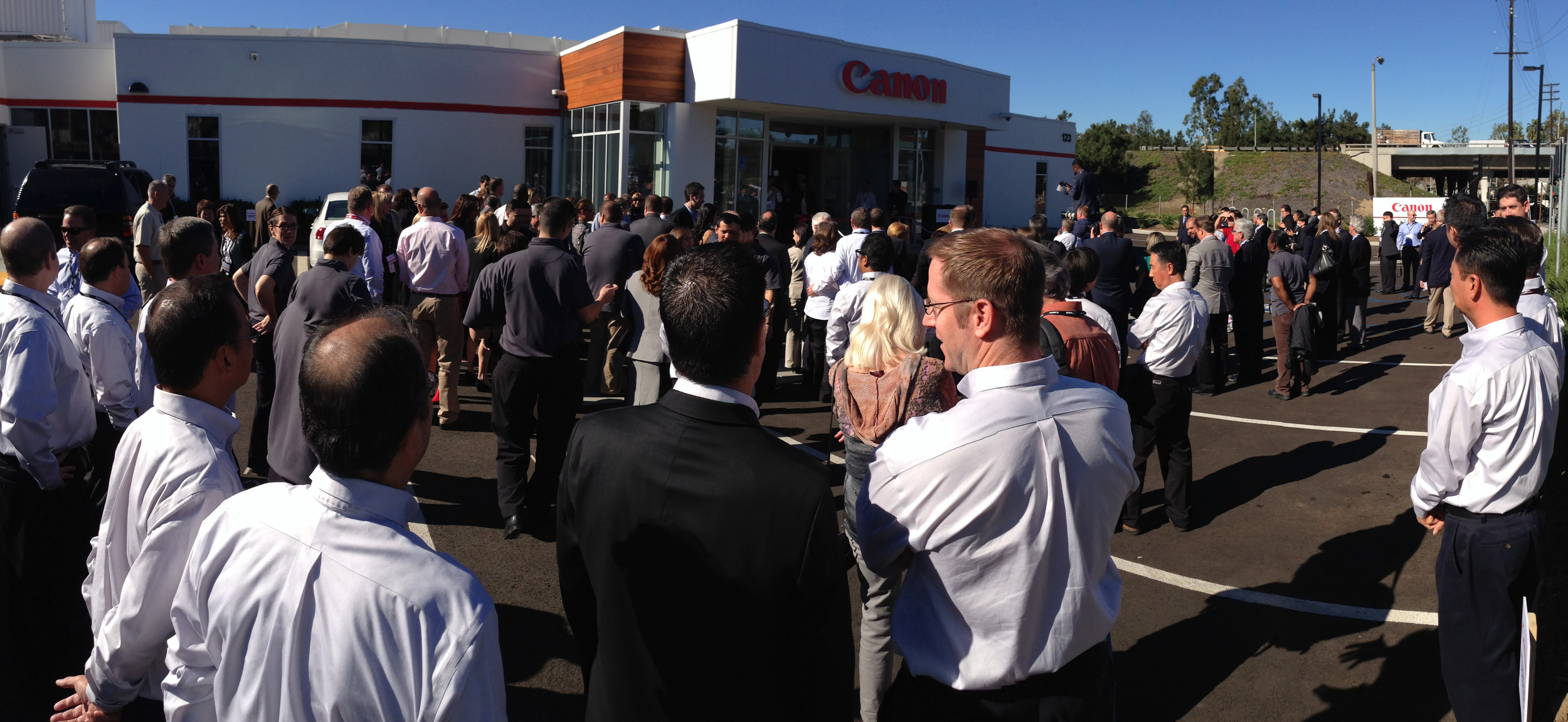 Crowd gathers for the Grand opening of the Canon Experience center in Coast Mesa, Ca.