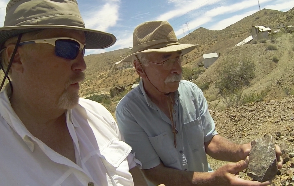 Gary showing me some ore that was last brought from deep below by the mine. Sat there since the day it closed long ago. Some chunks still have a little gold. I'm rich...or is it fool's gold?